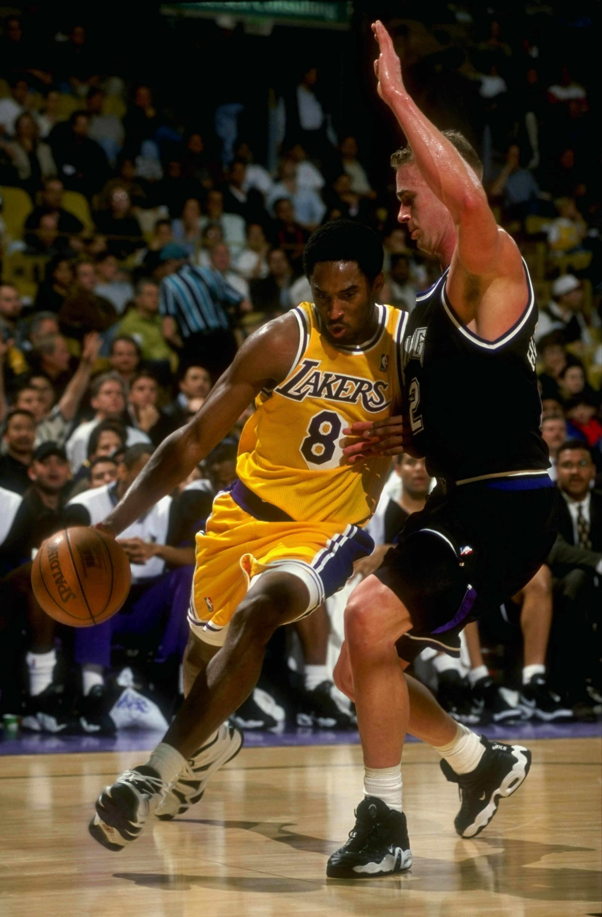 25 Mar 1998:  Guard Kobe Bryant of the Los Angeles Lakers in action against forward Mark Hendrickson of the Sacramento Kings during a game at the Great Western Forum in Inglewood, California.  The Lakers defeated the Kings 114-91. Mandatory Credit: Vincen