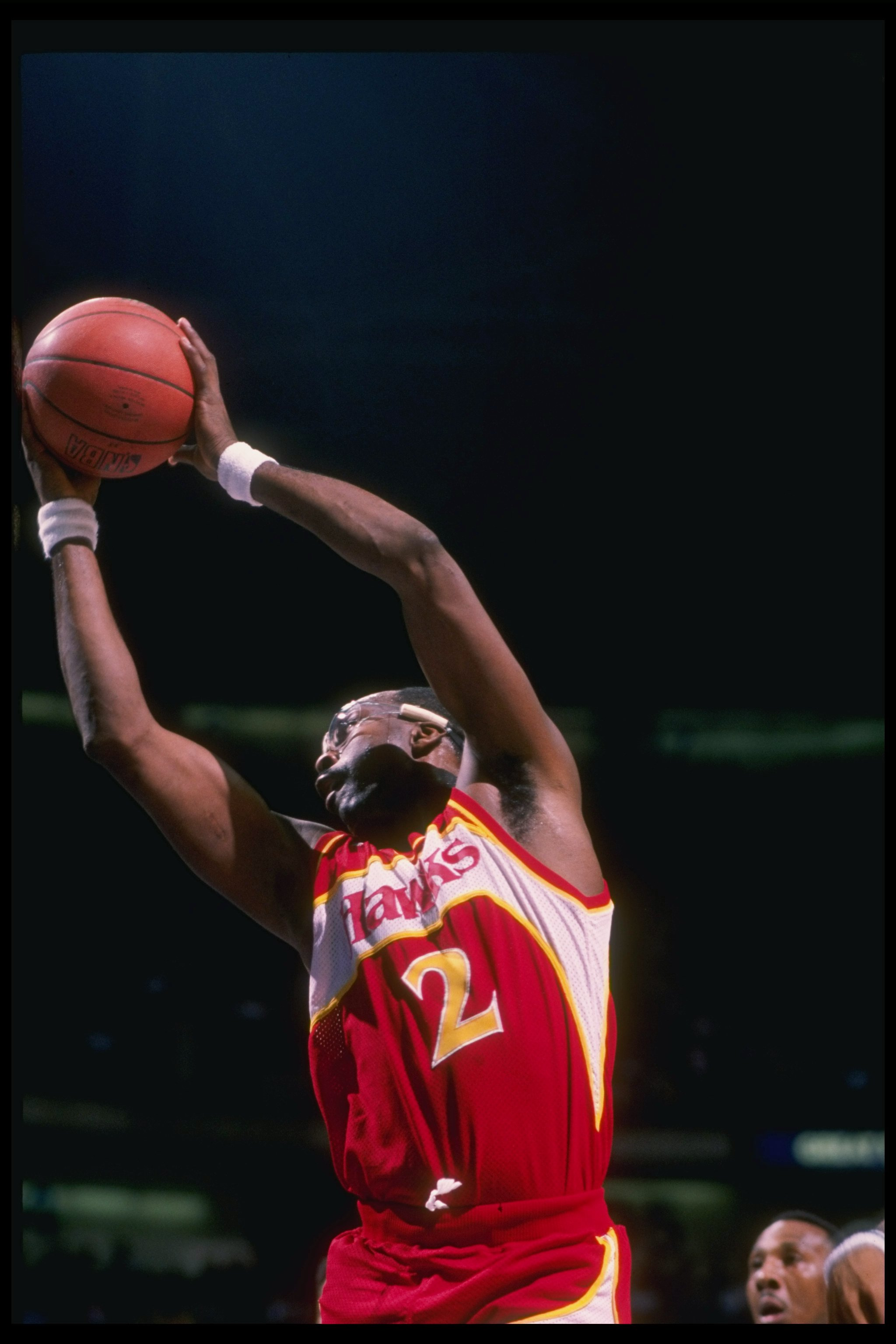 Center Moses Malone of the Atlanta Hawks jumps to the basket during a game.