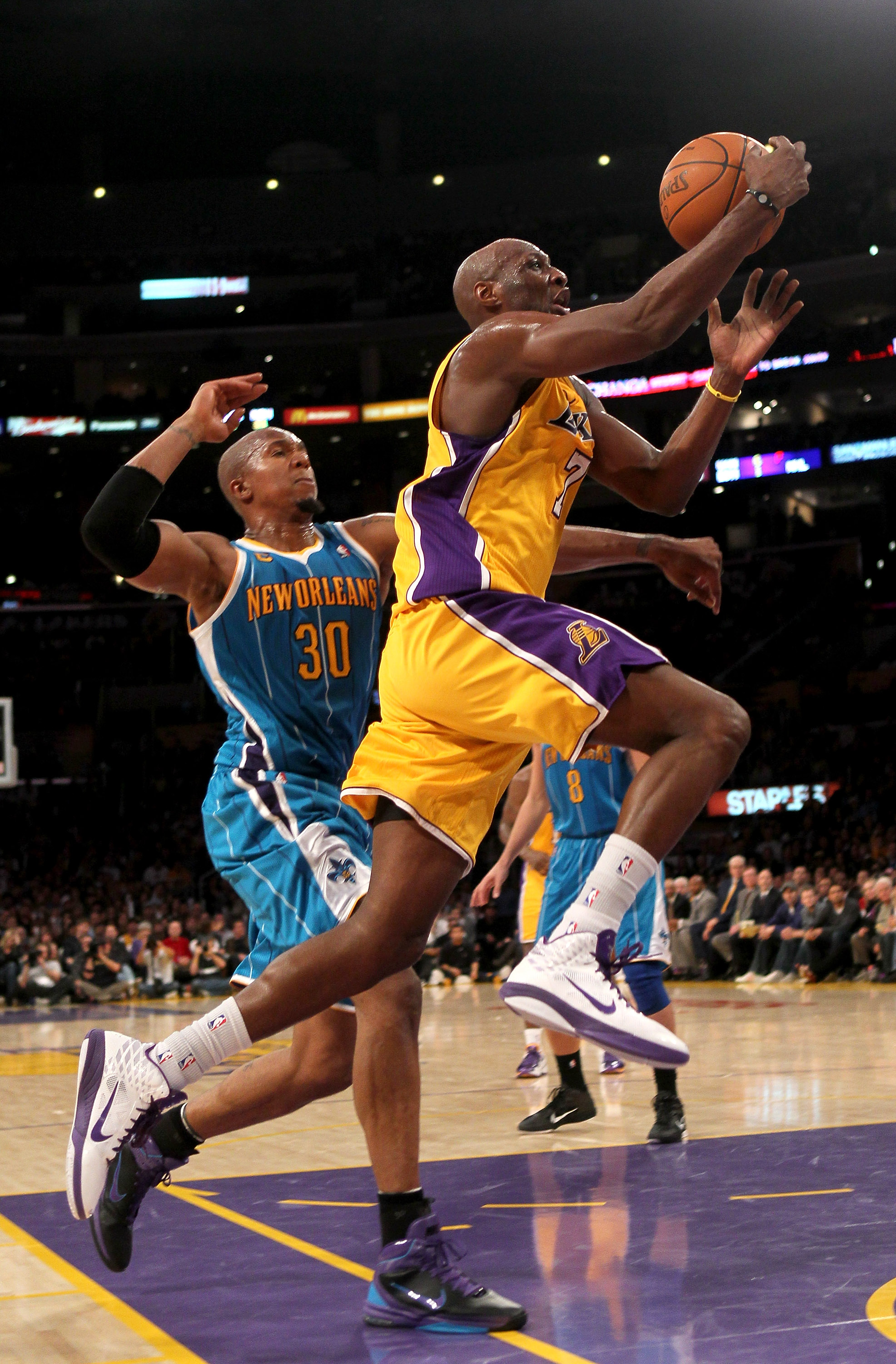 LOS ANGELES, CA - JANUARY 07:  Lamar Odom #7 of the Los Angeles Lakers goes up for a shot past David West #30 of the New Orleans Hornets at Staples Center on January 7, 2011 in Los Angeles, California.  The Lakers won 101-97.  NOTE TO USER: User expressly