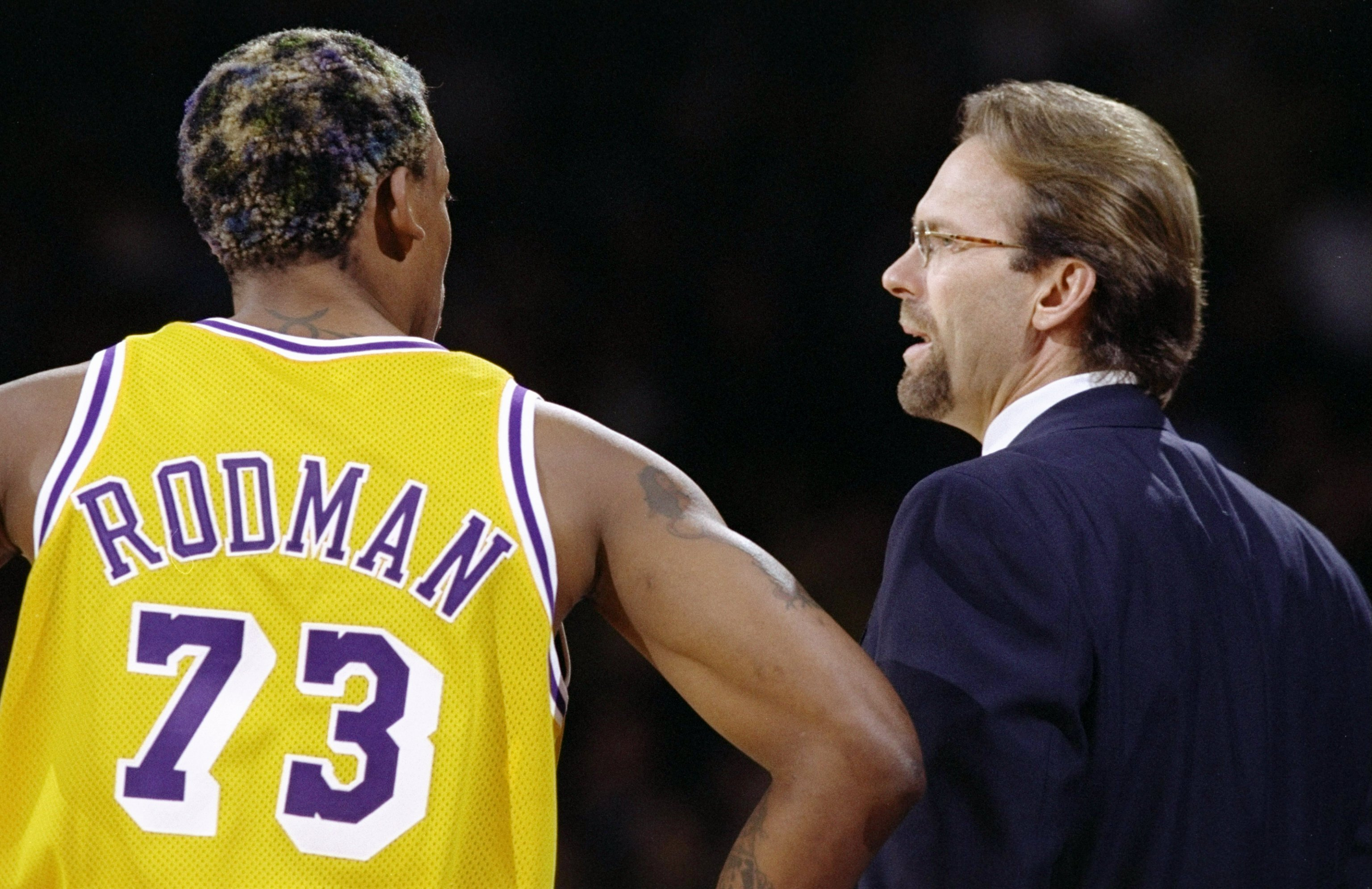 26 Feb 1999: Dennis Rodman #73 of the Los Angeles Lakers talks to new head coach Kurt Rambis during the game against the Los Angeles Clippers at the Great Western Forum in Inglewood, California. The Lakers defeated the Clippers 99-83.  Mandatory Credit: E