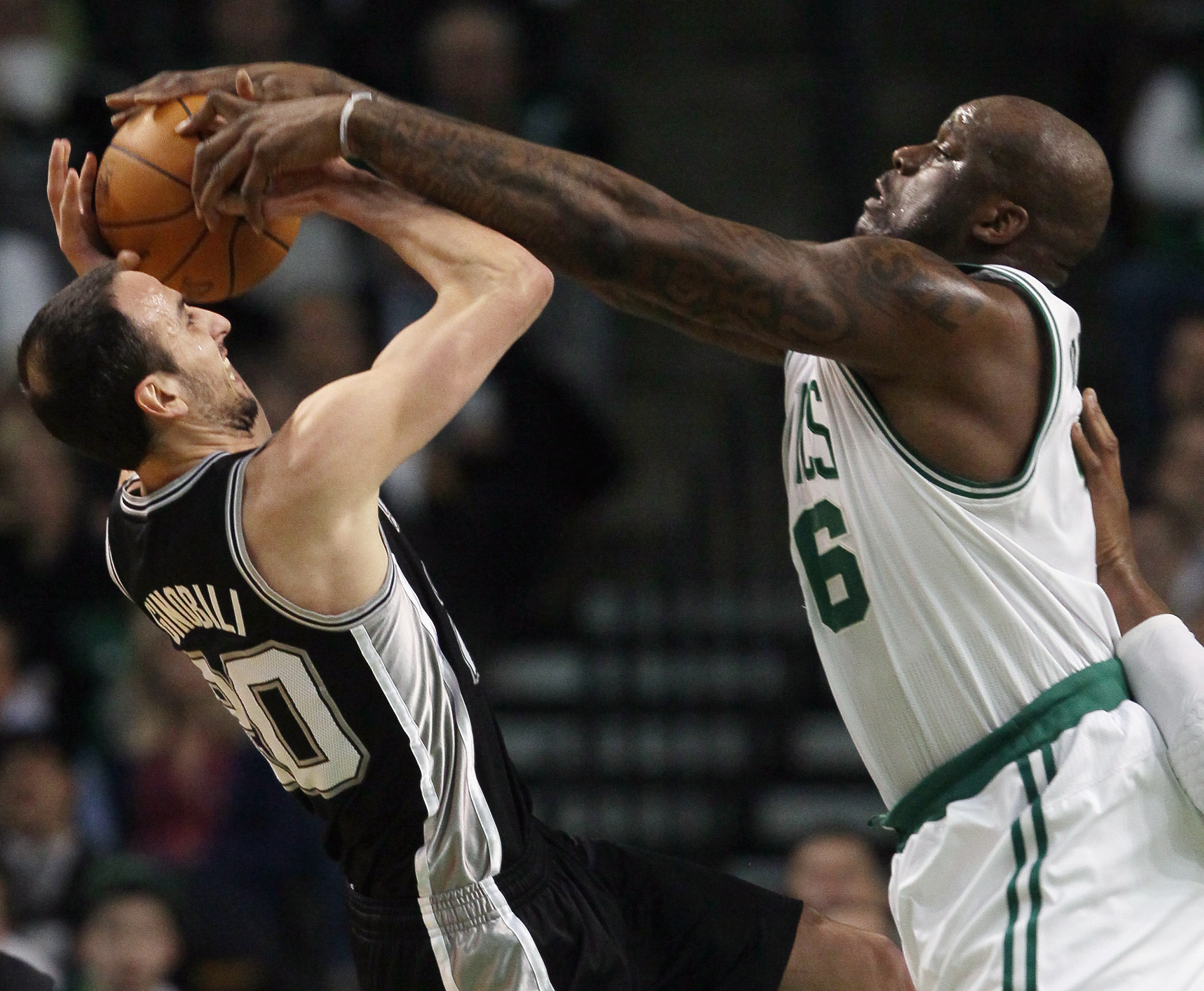 BOSTON, MA - JANUARY 05:  Manu Ginobili #20 of the San Antonio Spurs tries to take a shot as Shaquille O'Neal #36 of the Boston Celtics attempts to block on January 5, 2011 at the TD Garden in Boston, Massachusetts. NOTE TO USER: User expressly acknowledg