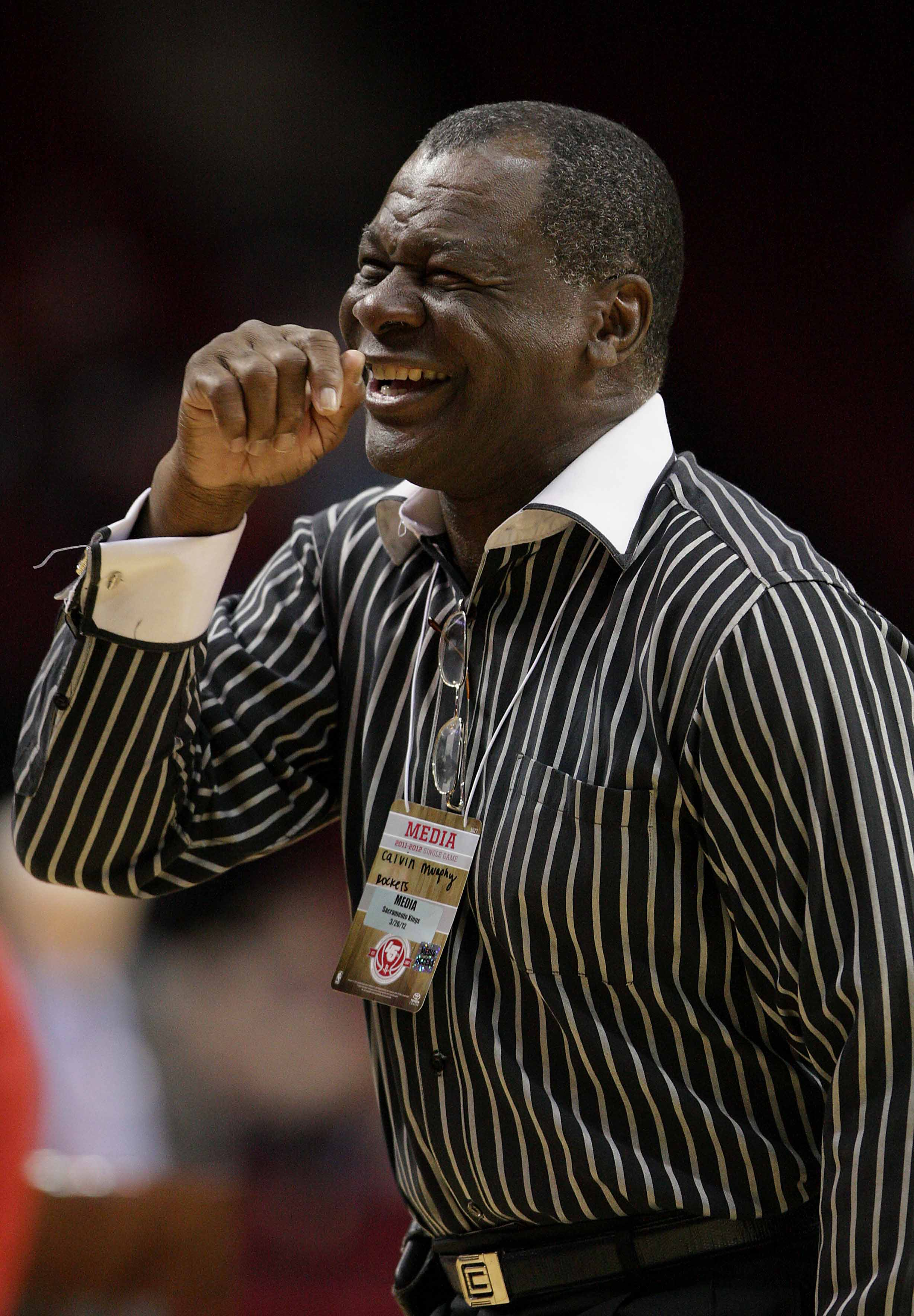 March 26, 2012; Houston, TX, USA; Houston Rocket former player Calvin Murphy laughs before a game against the Sacramento Kings at Toyota Center. Mandatory Credit: Troy Taormina-USA TODAY Sports