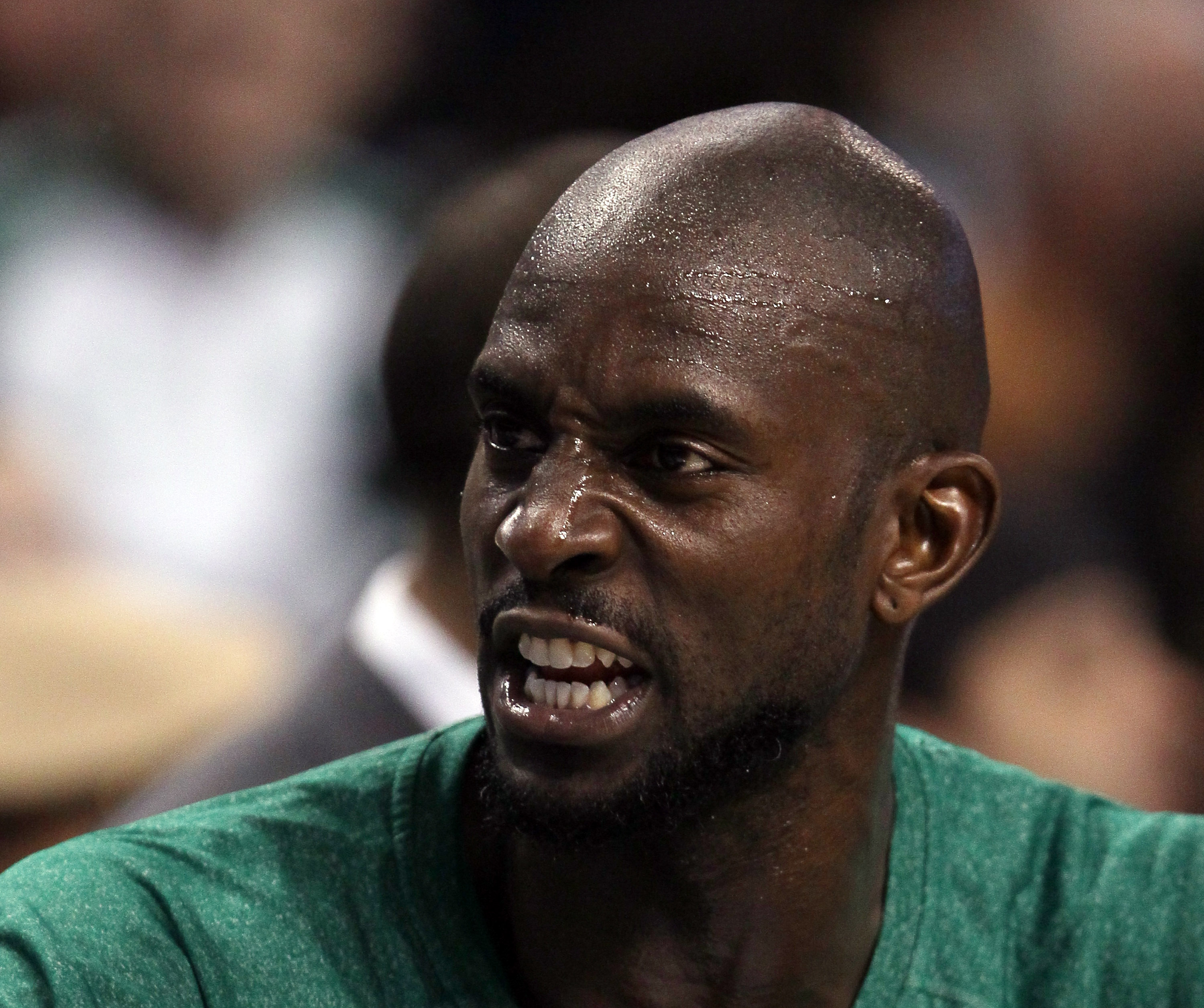 BOSTON, MA - DECEMBER 16:  Kevin Garnett #5 of the Boston Celtics talks on the bench in the first half against the Atlanta Hawks on December 16, 2010 at the TD Garden in Boston, Massachusetts. NOTE TO USER: User expressly acknowledges and agrees that, by
