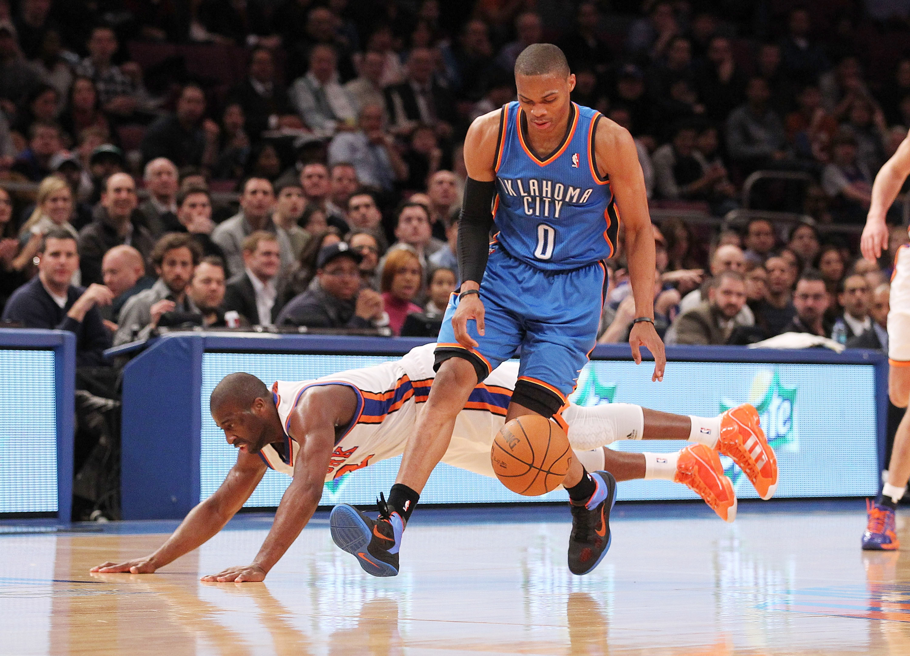 NEW YORK, NY - DECEMBER 22:  Raymond Felton #2 of the New York Knicks collides with Russell Westbrook #0 of the Oklahoma City Thunder at Madison Square Garden on December 22, 2010 in New York City.   NOTE TO USER: User expressly acknowledges and agrees th