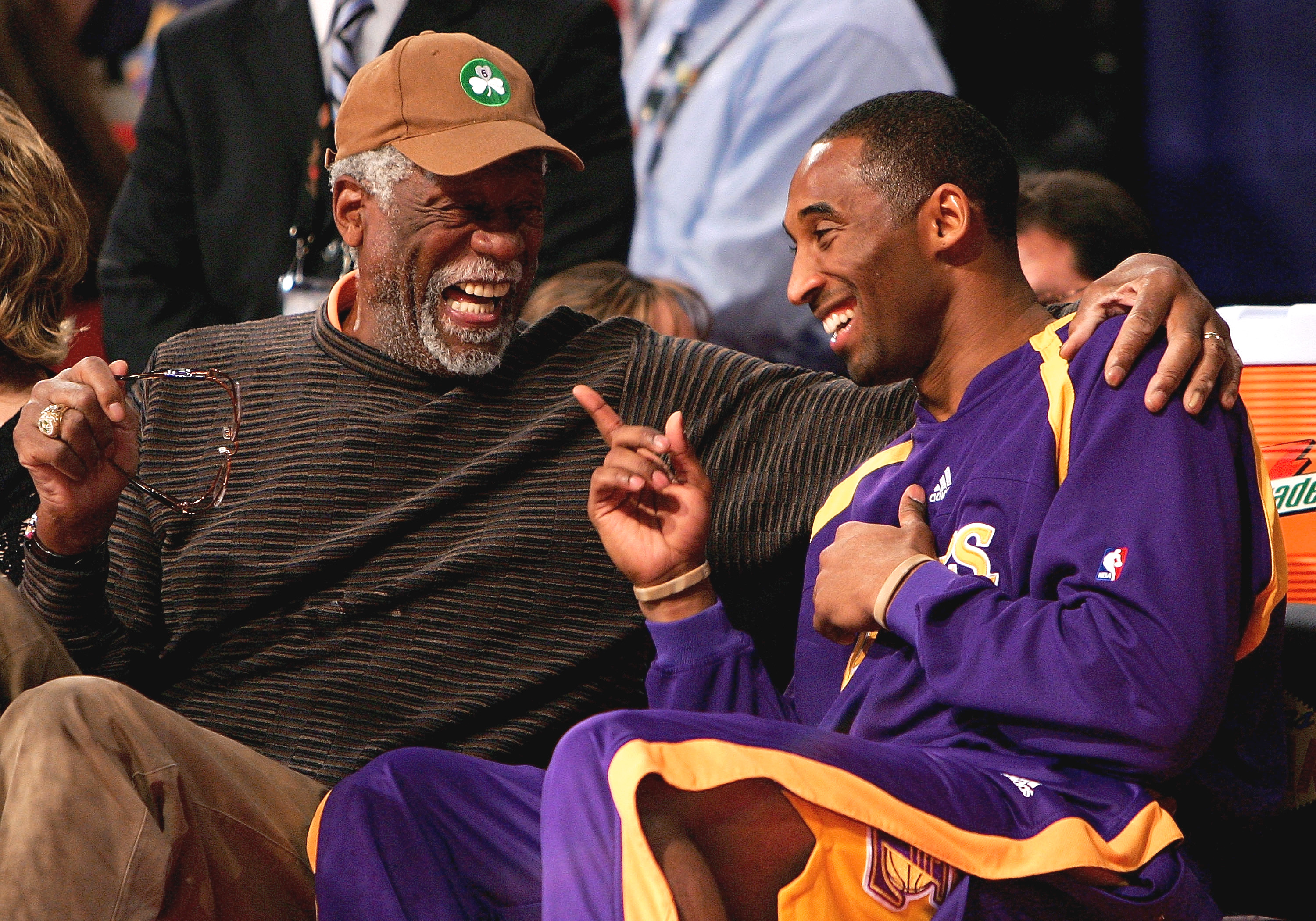 LAS VEGAS - FEBRUARY 17:  NBA legend Bill Russell and Kobe Bryant of the Los Angeles Lakers laugh on the sidelines during the Haier Shooting Stars Competition during NBA All-Star Weekend on February 17, 2007 at Thomas & Mack Center in Las Vegas, Nevada.