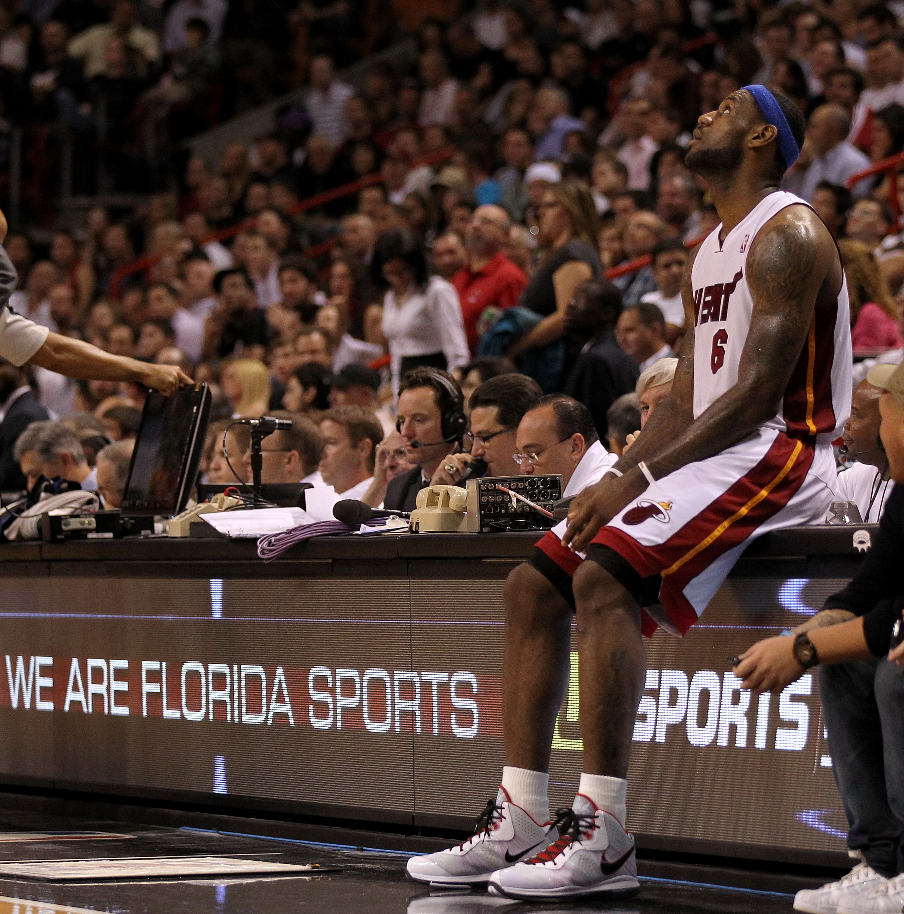 MIAMI, FL - JANUARY 04:  LeBron James #6 of the Miami Heat waits on the scorers table during a game against the Milwaukee Bucks at American Airlines Arena on January 4, 2011 in Miami, Florida. NOTE TO USER: User expressly acknowledges and agrees that, by