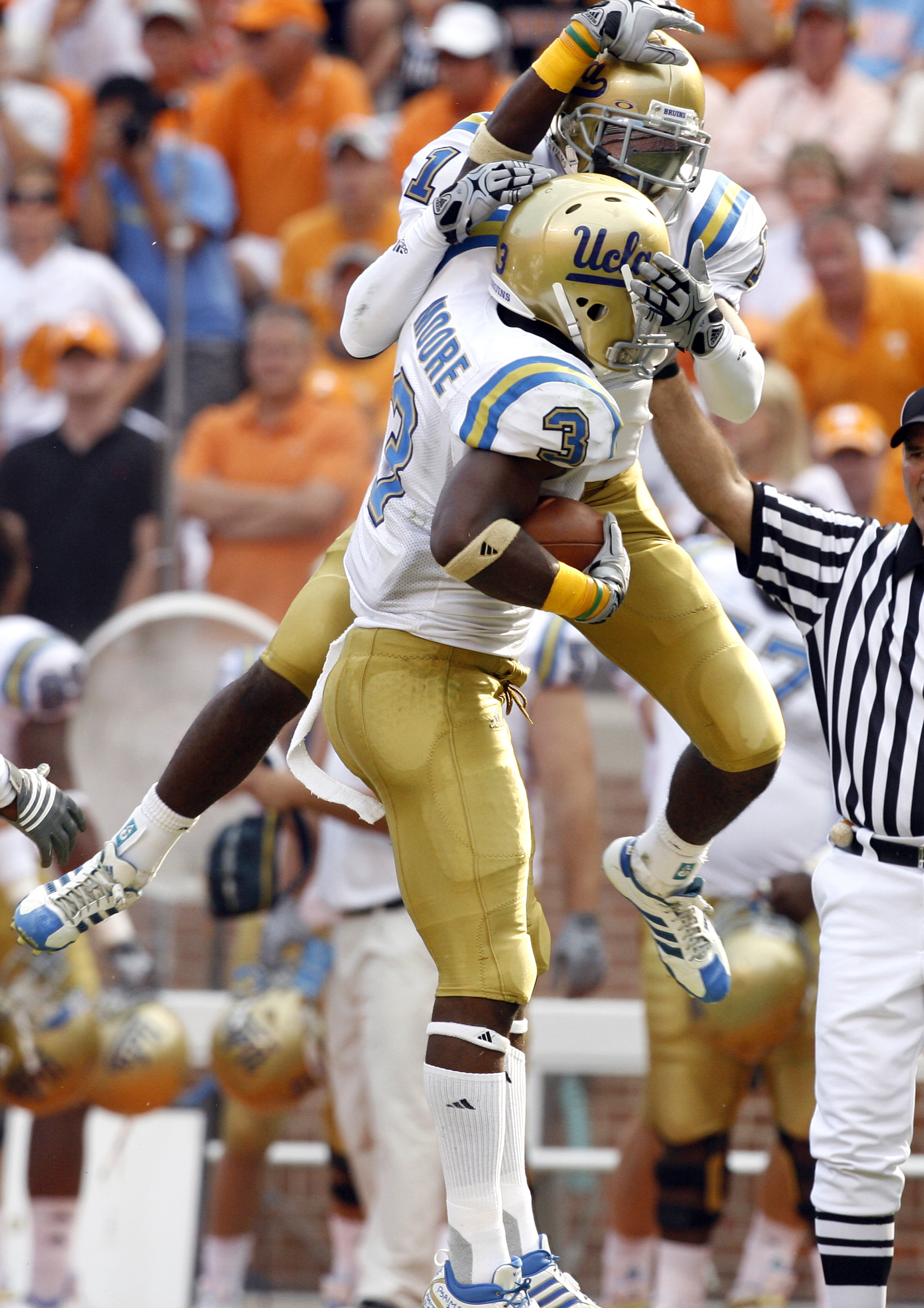 KNOXVILLE, TN - SEPTEMBER 12: Alterraun Verner #1 celebrates the interception by Rahim Moore #3 of the UCLA Bruins against the Tennessee Volunteers on September 12, 2009 at Neyland Stadium in Knoxville, Tennessee. (Photo by Joe Murphy/Getty Images)