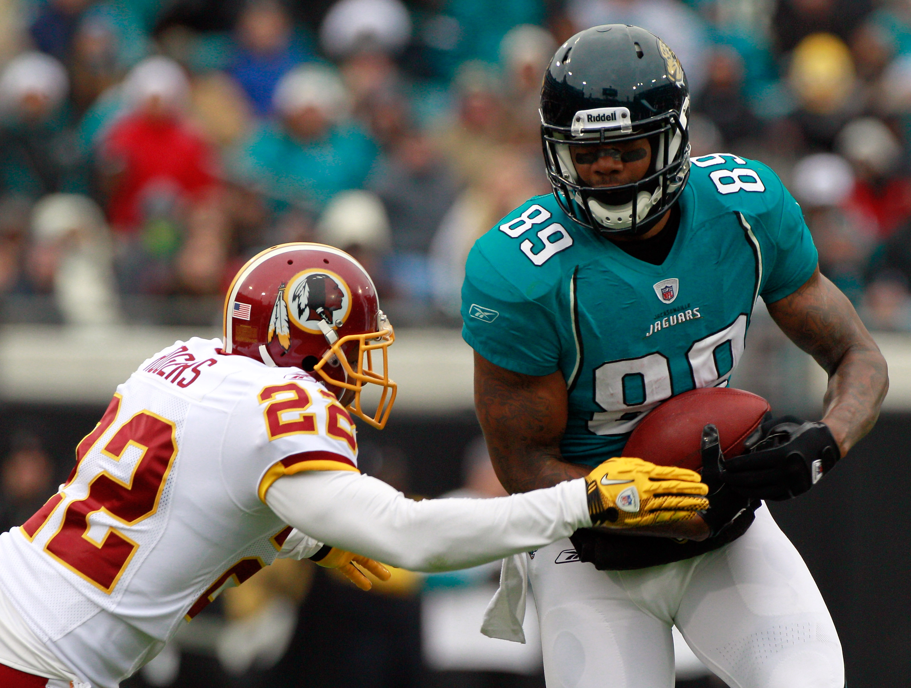 JACKSONVILLE, FL - DECEMBER 26:  Carlos Rogers #22 of the Washington Redskins attempts to tackle #89 Marcedes Lewis #89 of the Jacksonville Jaguars  during the game at EverBank Field on December 26, 2010 in Jacksonville, Florida.  (Photo by Sam Greenwood/
