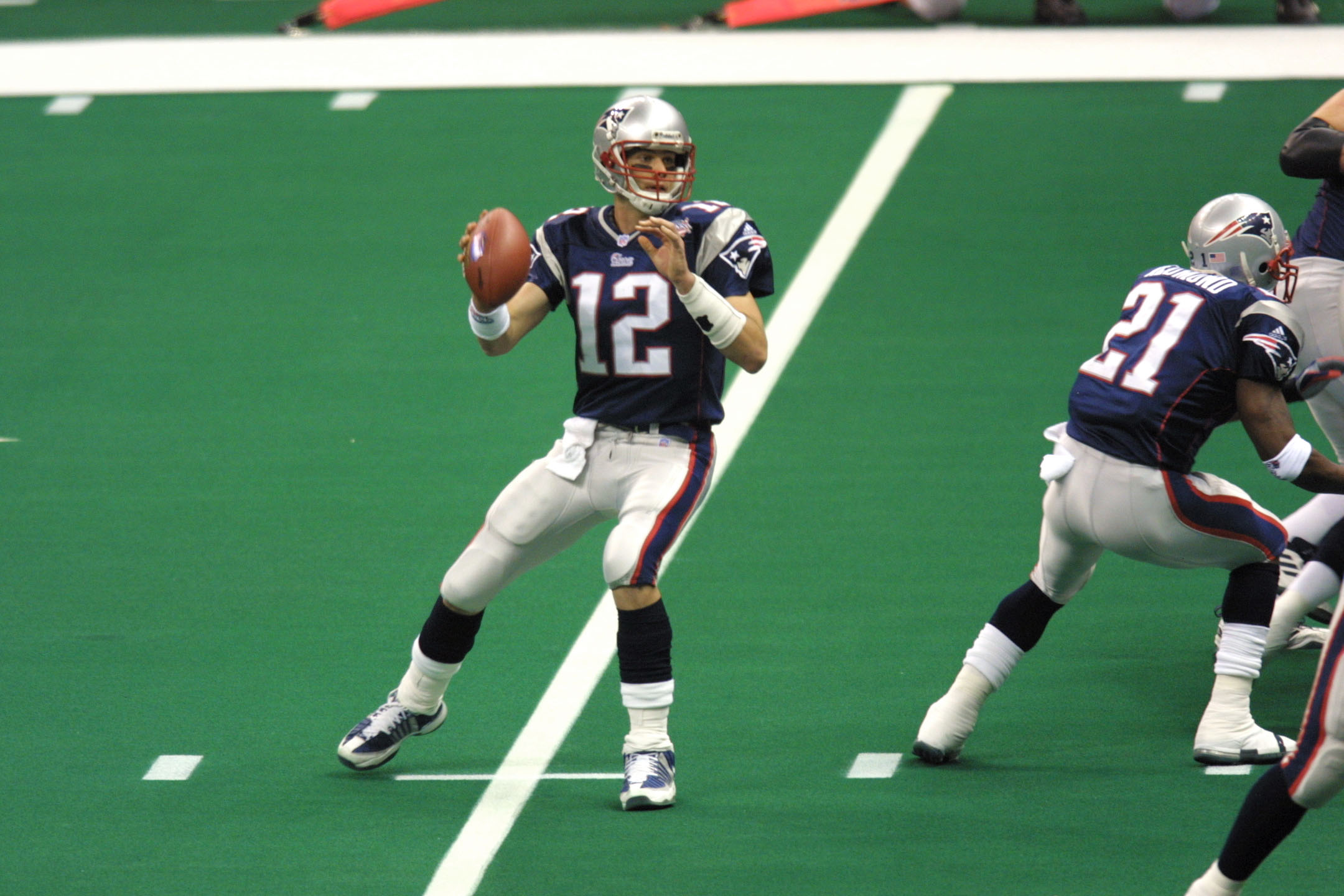 03 Feb 2002:  Quarterback Tom Brady #12 of the New England Patriots looks to throw a pass against the St.Louis Rams  during Superbowl XXXVI at the Superdome in New Orleans, Louisiana.  The Patriots defeated the Rams 20-17. DIGITAL IMAGE. Mandatory Credit: