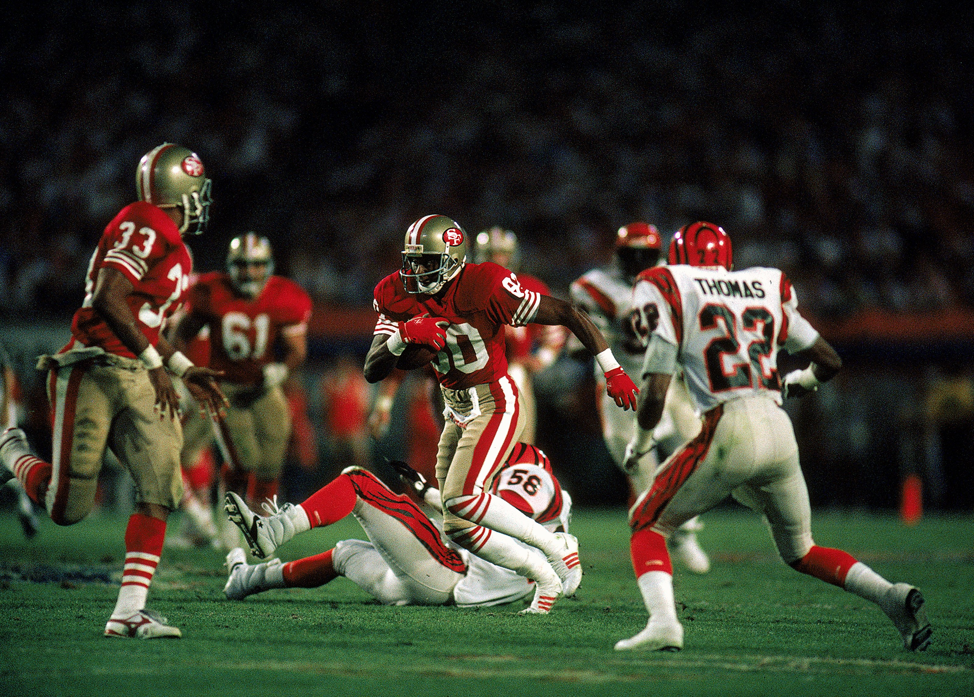 Jerry Rice #80 of the San Francisco 49ers carries the ball during the Super Bowl XXIII against the Cincinnati Bengals, January 22, 1989. The 49ers defeated the Bengals 20-10. Mandatory Credit: Mike Powell  /Allsport