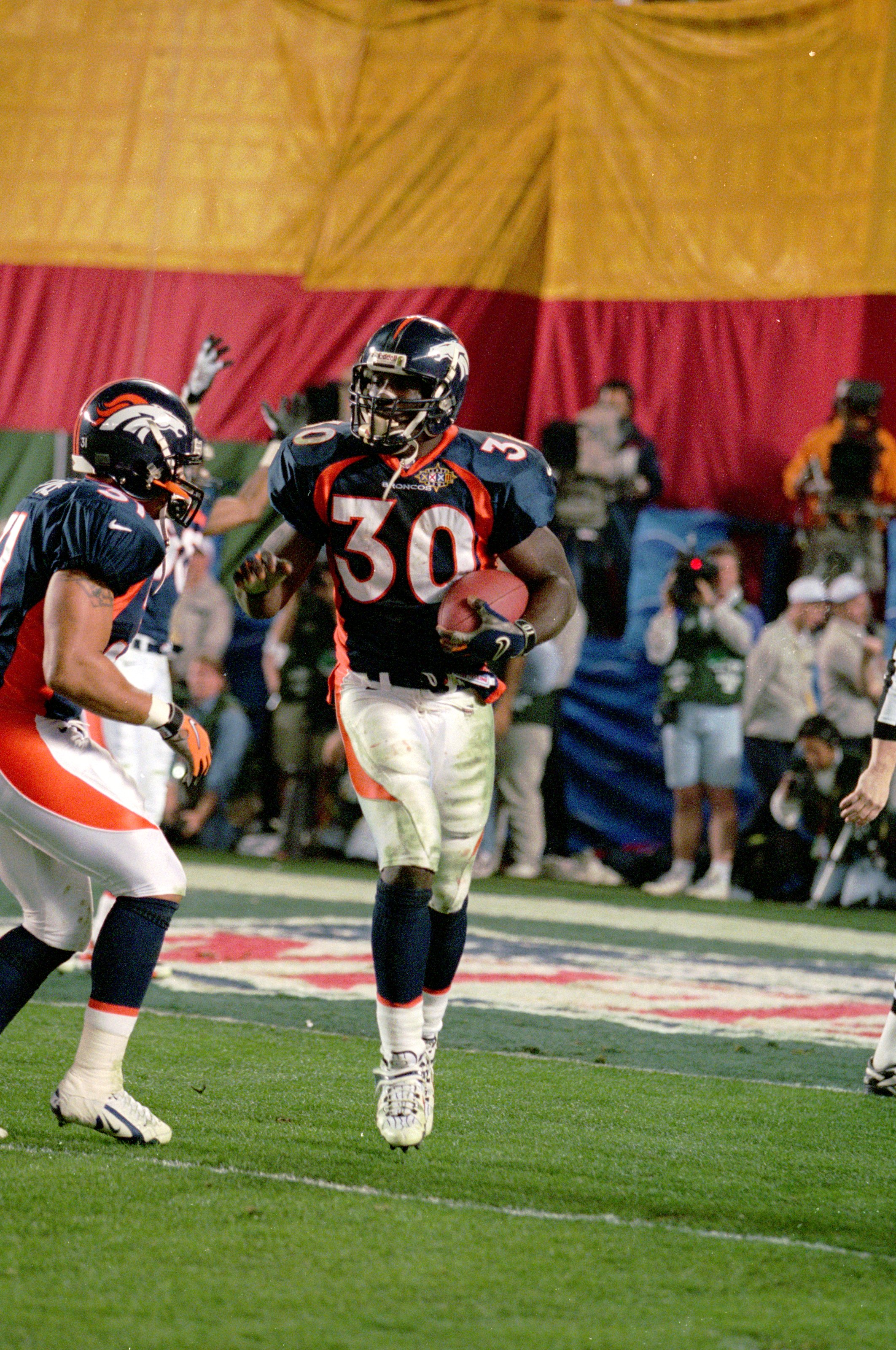 25 Jan 1998:  Terrell Davis #30 of the Denver Broncos celebrates scoring a touch down during the NFL Super Bowl XXXII Game against the Green Bay Packers at the Qualcomm Stadium in San Diego, California. The Broncos defeated the Packers 31-24. Mandatory Cr