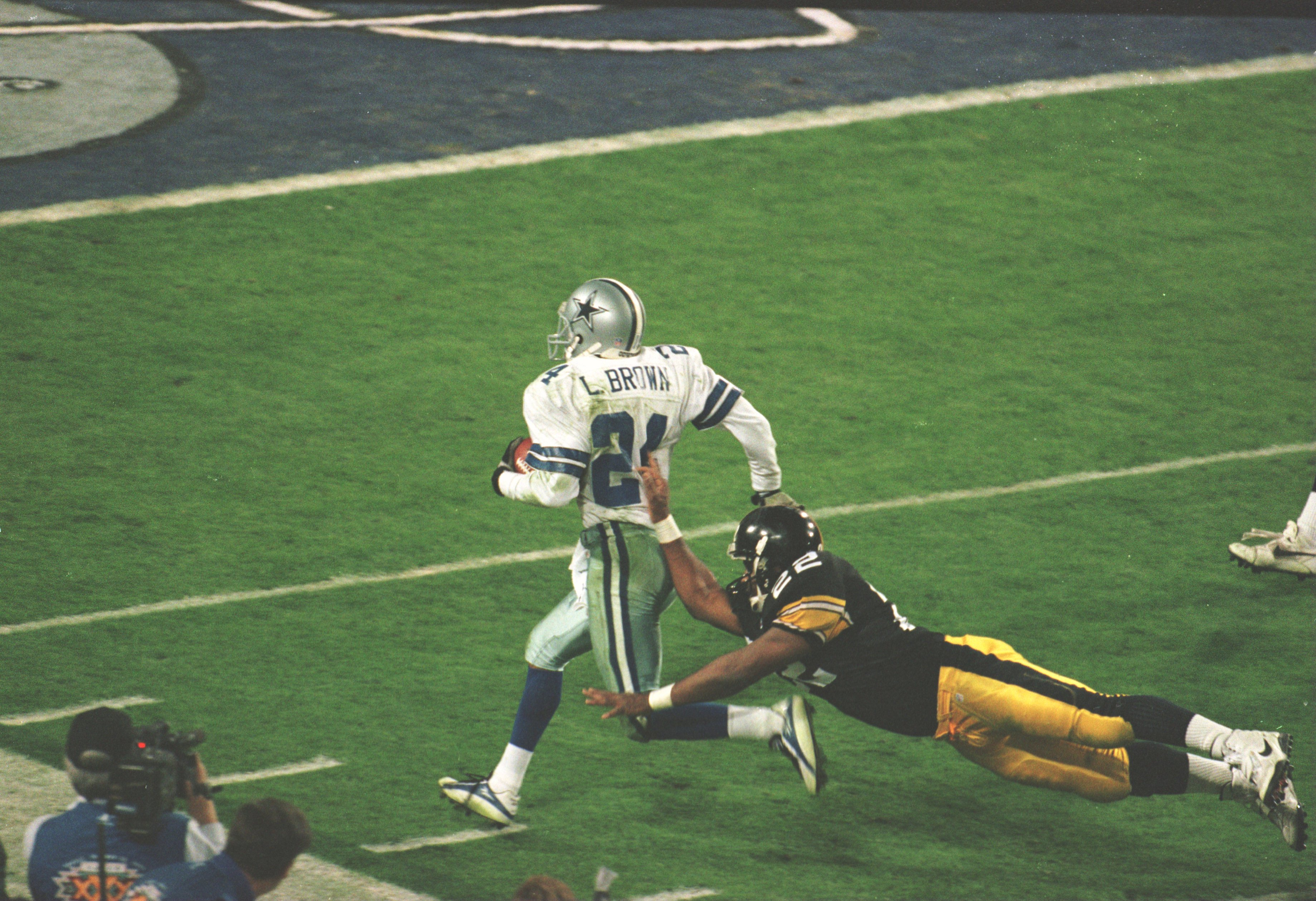 28 Jan 1996:  Cornerback Larry Brown of the Dallas Cowboys is pushed out of bounds by running back John L. Williams of the Pittsburgh Steelers during the 4th quarter of the Cowboys game versus the Steelers in Super Bowl XXX at Sun Devil Stadium in Tempe,