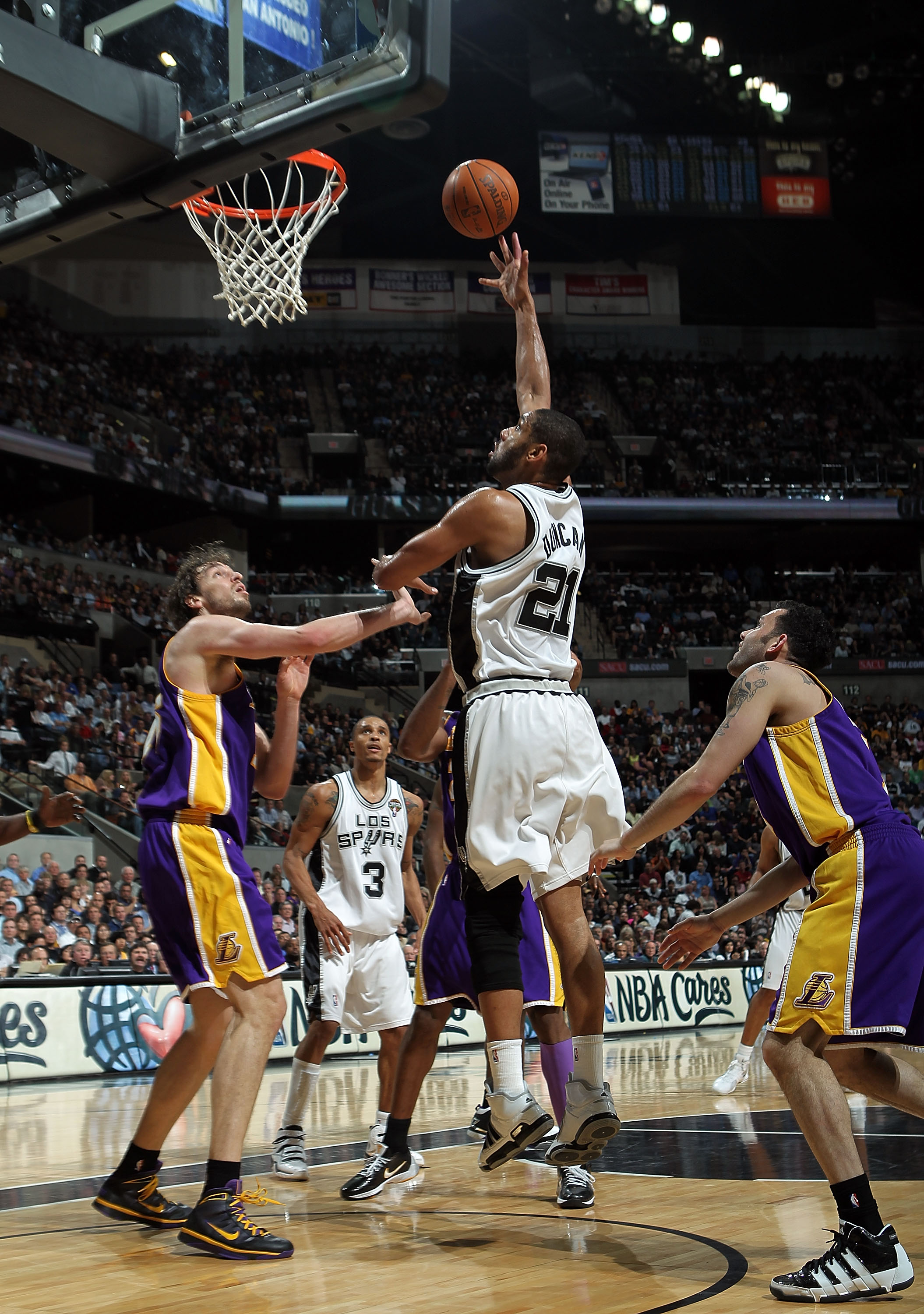 SAN ANTONIO - MARCH 24: Forward Tim Duncan #21 of the San Antonio Spurs takes a shot against Pau Gasol #16 of the Los Angeles Lakers at AT&T Center on March 24, 2010 in San Antonio, Texas. NOTE TO USER: User expressly acknowledges and agrees that, by down