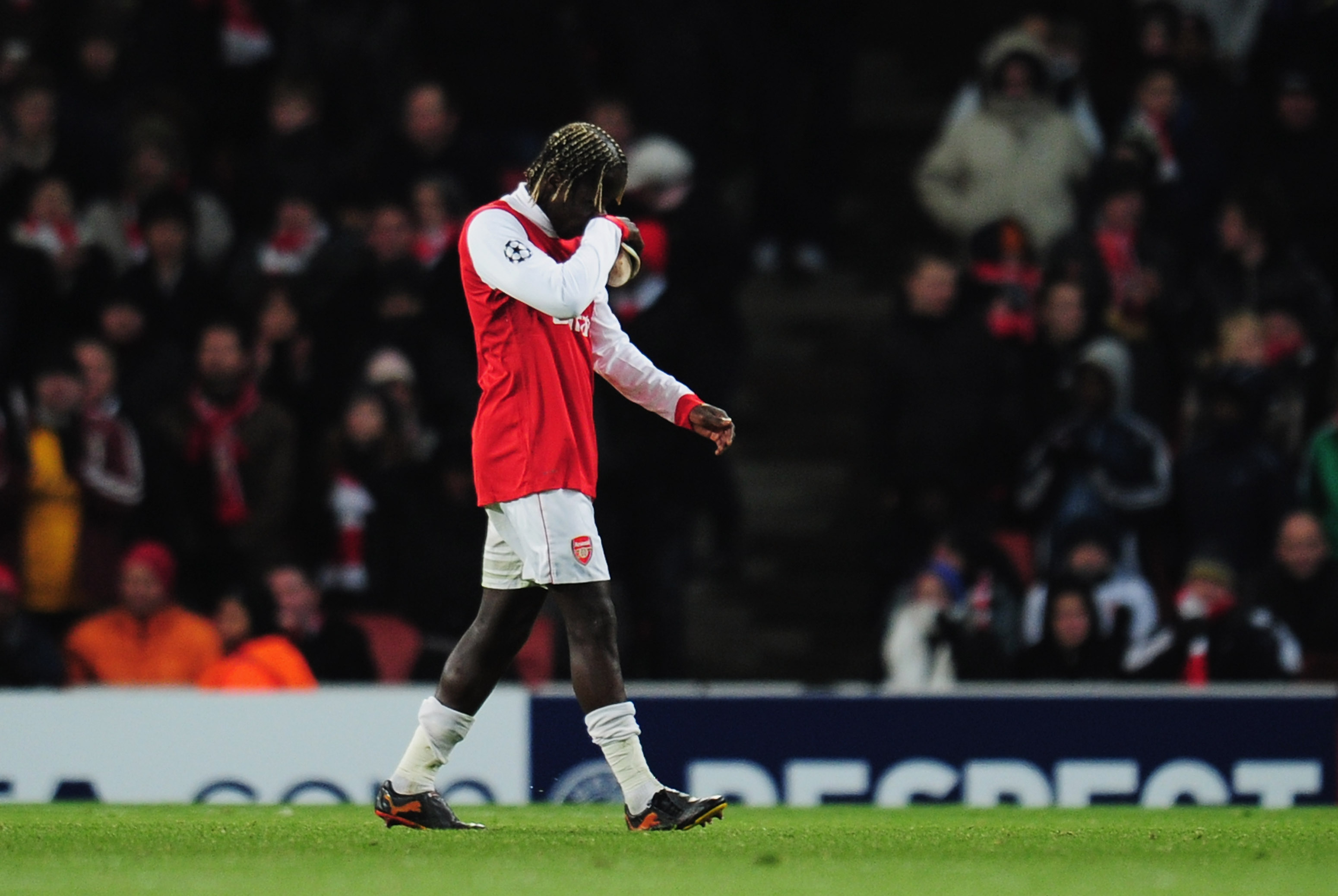 LONDON, ENGLAND - DECEMBER 08:  Despair for Bacary Sagna of Arsenal as he is sent off during UEFA Champions League Group H match between Arsenal and FK Partizan Belgrade at the Emirates Stadium on December 8, 2010 in London, England.  (Photo by Shaun Bott