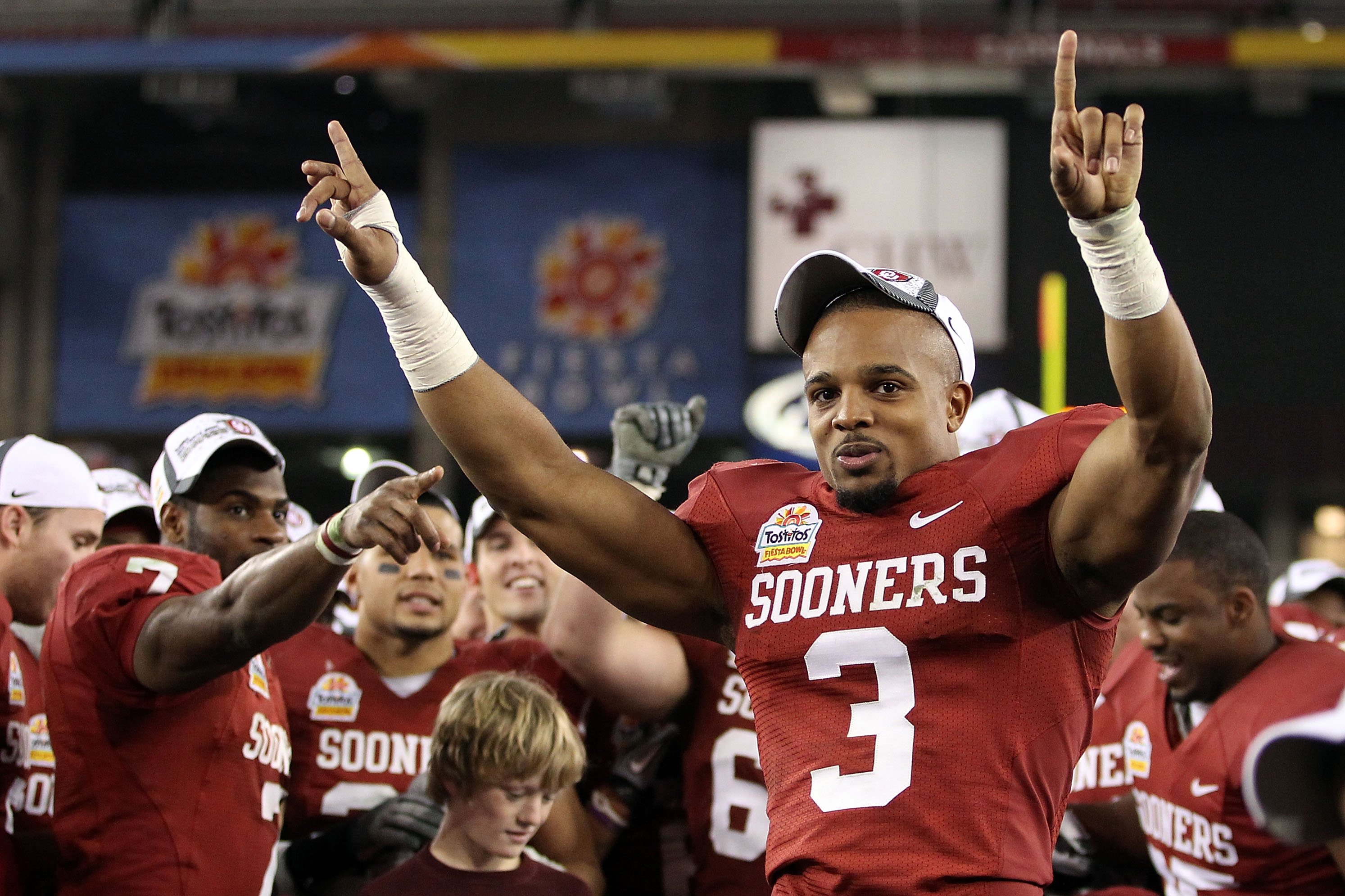 GLENDALE, AZ - JANUARY 01:  Jonathan Nelson #3 of the Oklahoma Sooners celebrates the Sooners 48-20 victory against the Connecticut Huskies during the Tostitos Fiesta Bowl at the Universtity of Phoenix Stadium on January 1, 2011 in Glendale, Arizona.  (Ph