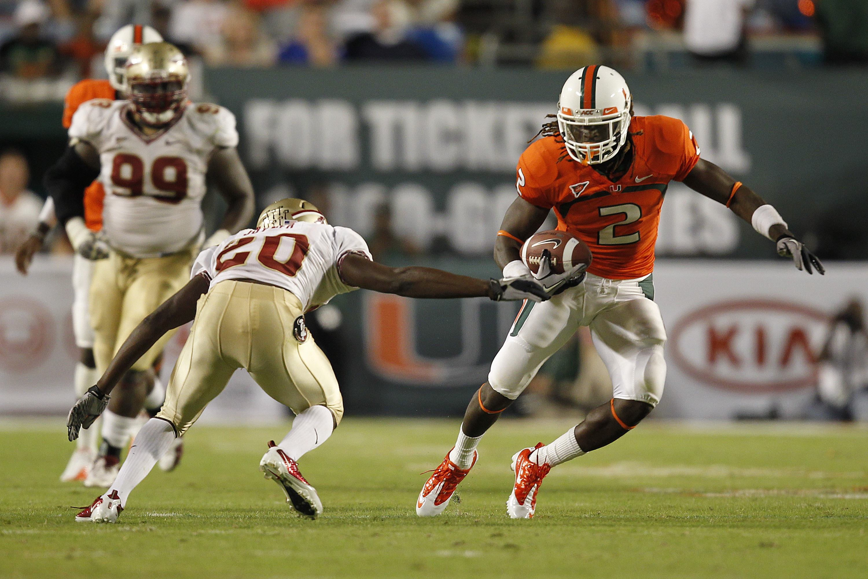 MIAMI, FL - OCTOBER 9: Graig Cooper #2 of the Miami Hurricanes runs with the ball and eludes the tackloe of Lamarcus Joyner #20 of the Florida State Seminoles on October 9, 2010 at Sun Life Stadium in Miami, Florida. (Photo by Joel Auerbach/Getty Images)
