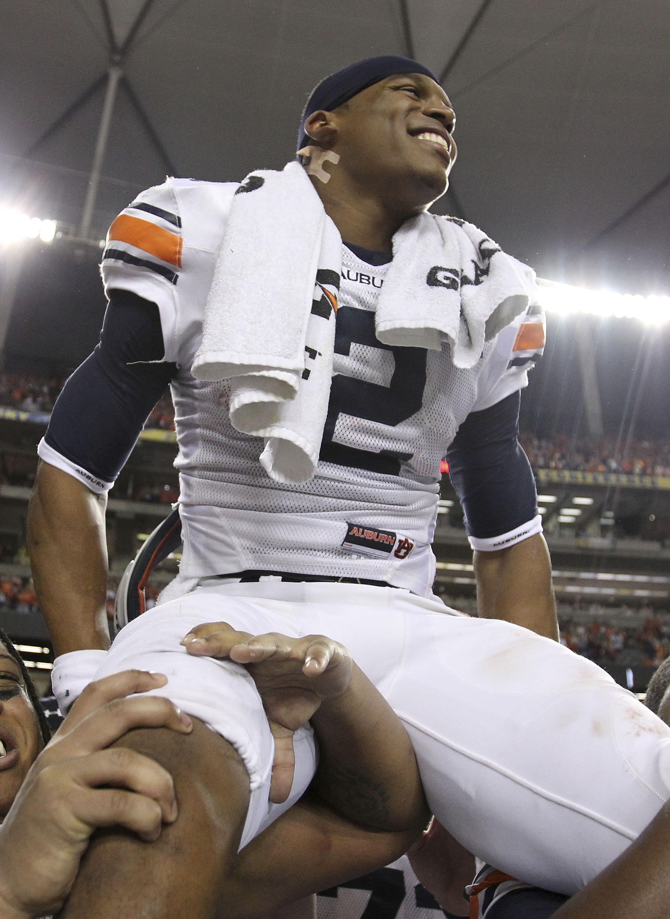 ATLANTA - DECEMBER 04:  Quarterback Cam Newton #2 of the Auburn Tigers is carried on the field after the 2010 SEC Championship against the South Carolina Gamecocks at Georgia Dome on December 4, 2010 in Atlanta, Georgia.  The Tigers beat the Gamecocks 56-