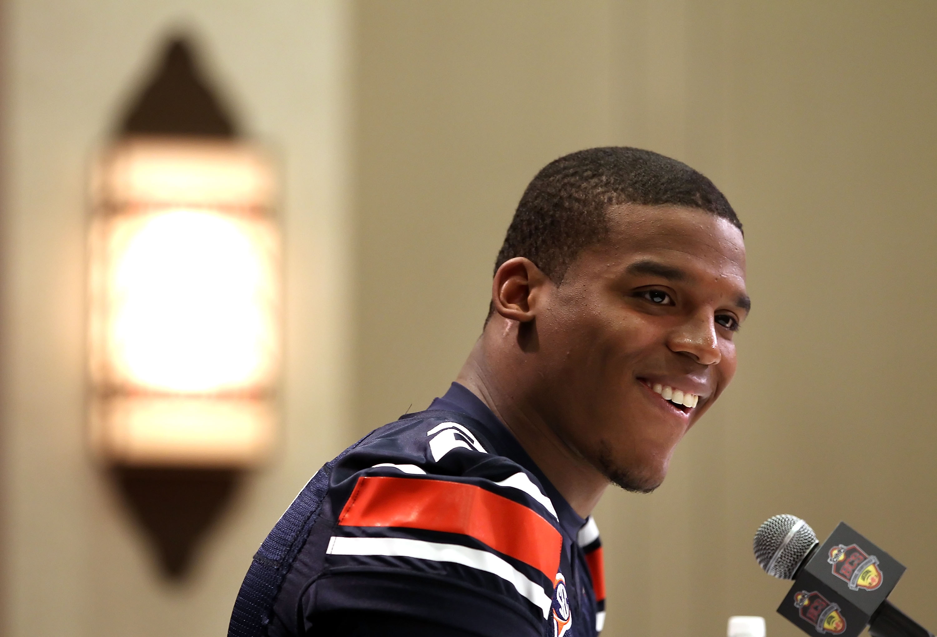 SCOTTSDALE, AZ - JANUARY 07:  Quarterback Cam Newton #2 of the Auburn Tigers speaks during Media Day for the Tostitos BCS National Championship Game at the JW Marriott Camelback Inn on January 7, 2011 in Scottsdale, Arizona.  (Photo by Christian Petersen/