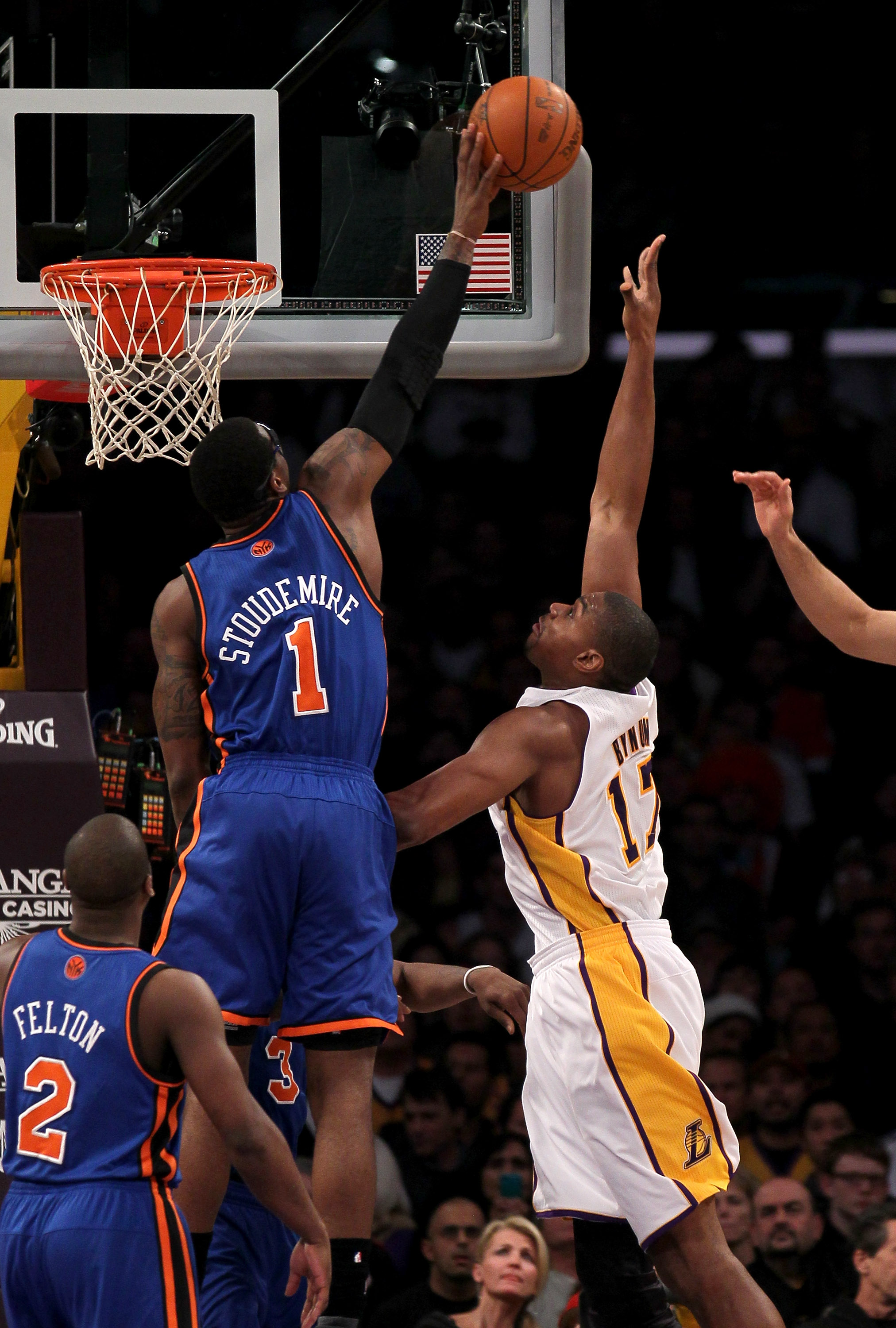 LOS ANGELES, CA - JANUARY 09:  Amar'e Stoudemire #1 of the New York Knicks blocks a shot by Andrew Bynum #17 of the Los Angeles Lakers at Staples Center on January 9, 2011 in Los Angeles, California.  NOTE TO USER: User expressly acknowledges and agrees t