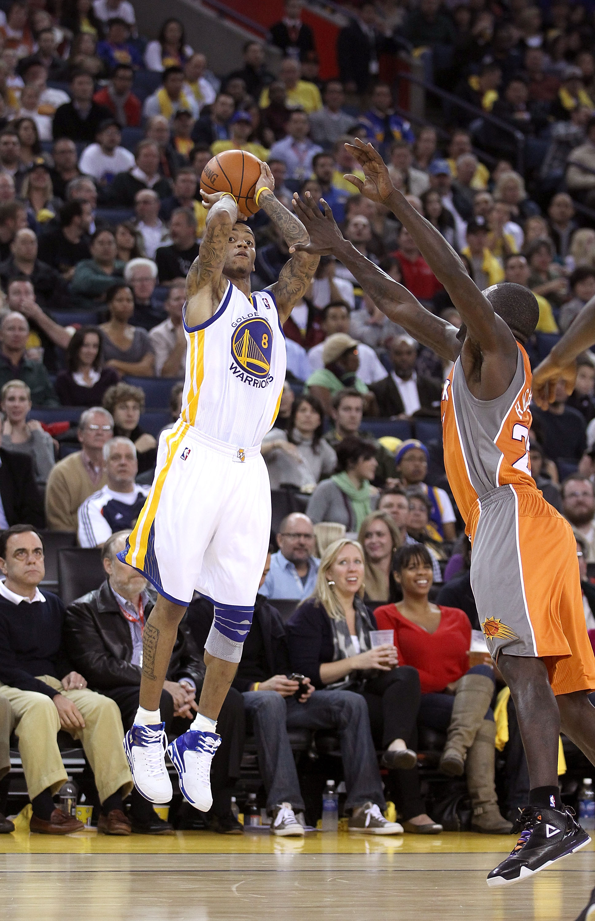 OAKLAND, CA - DECEMBER 02:  Monta Ellis #8 of the Golden State Warriors in action against the Phoenix Suns at Oracle Arena on December 2, 2010 in Oakland, California. NOTE TO USER: User expressly acknowledges and agrees that, by downloading and or using t