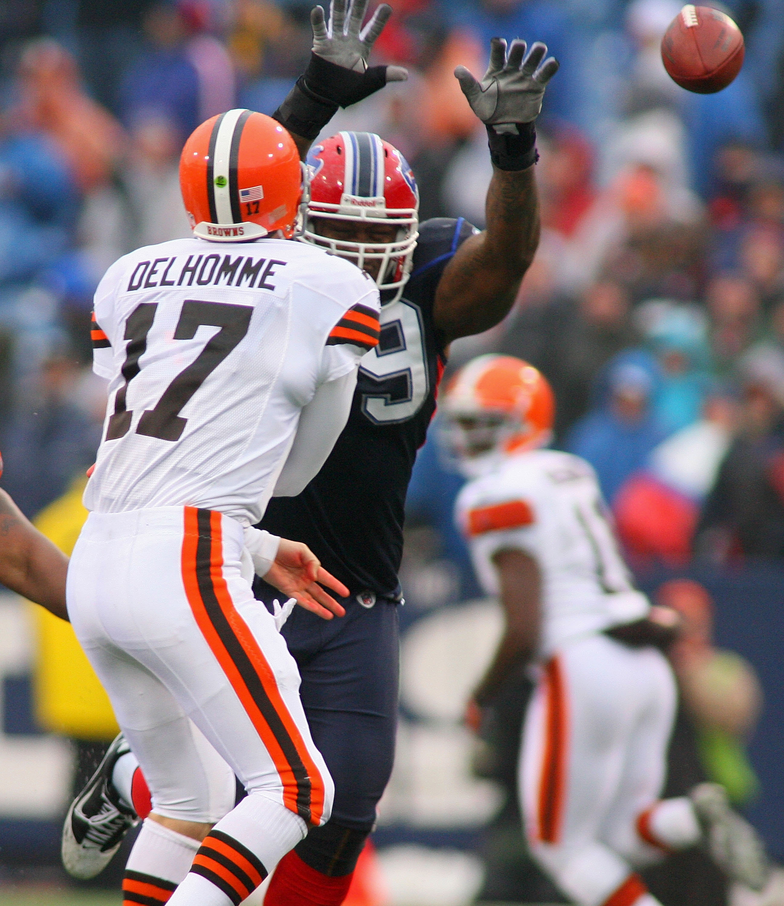 ORCHARD PARK, NY - DECEMBER 12:  Jake Delhomme #17 of the Cleveland Browns throws a pass with pressure from Marcus Stroud #99 of the Buffalo Bills  at Ralph Wilson Stadium on December 12, 2010 in Orchard Park, New York.  (Photo by Rick Stewart/Getty Image