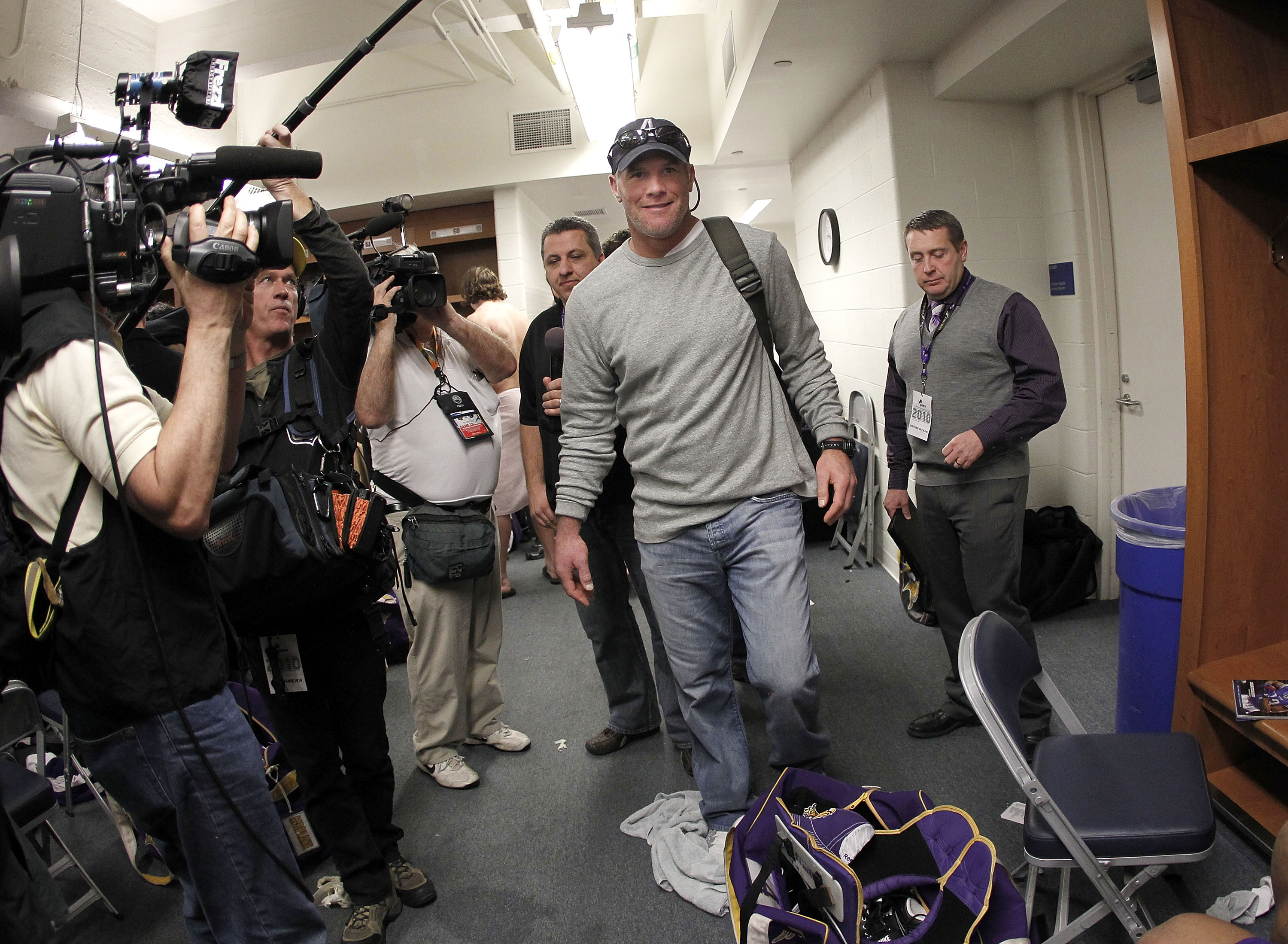 DETROIT, MI - JANUARY 02:  Brett Favre #4 of the Minnesota Vikings heads to a post game press conference after a 13-20 loss to the Detroit Lions at Ford Field on January 2, 2011 in Detroit, Michigan.  (Photo by Gregory Shamus/Getty Images)