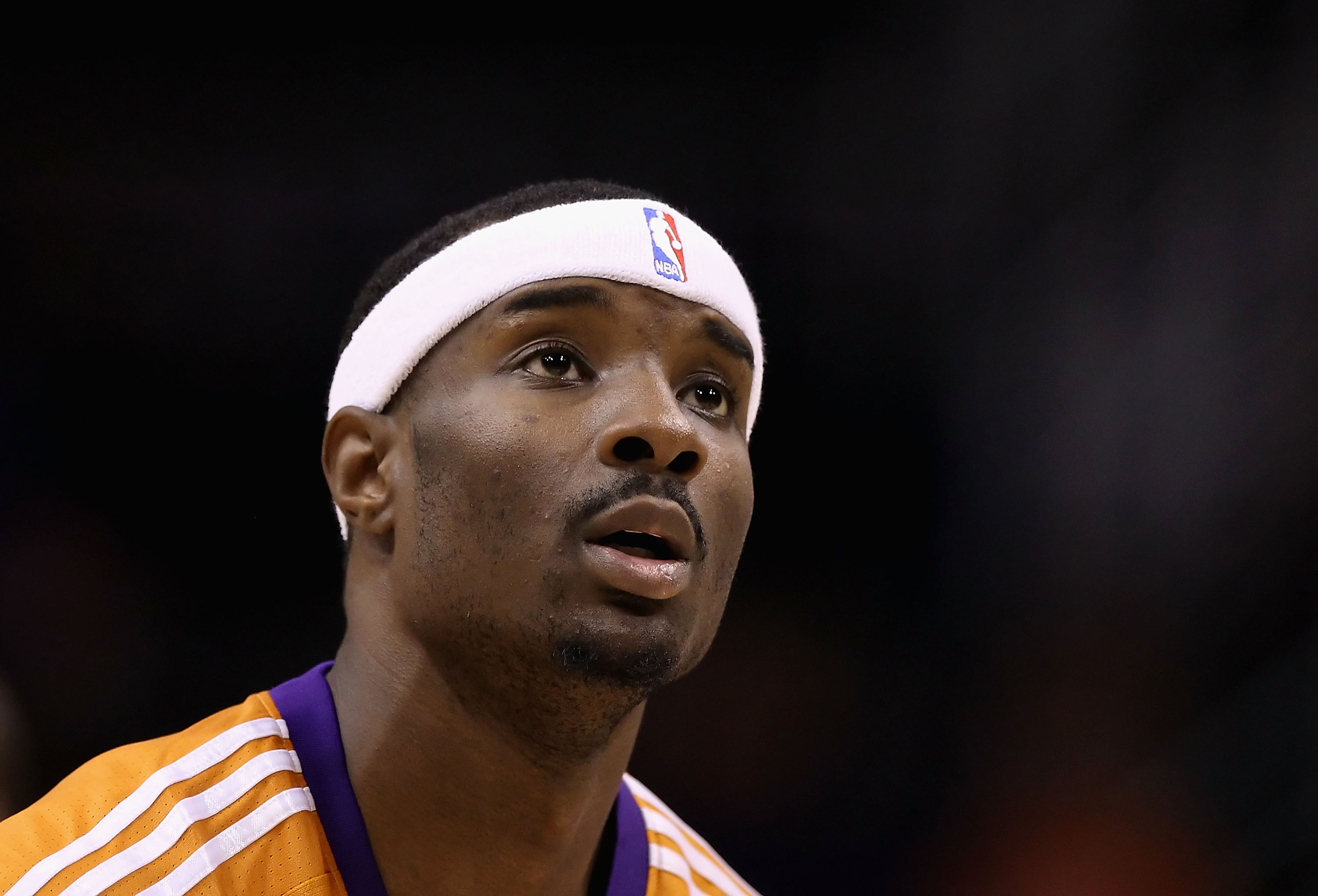PHOENIX - OCTOBER 12:  Gani Lawal #31 of the Phoenix Suns warms up before the preseason NBA game against the Utah Jazz at US Airways Center on October 12, 2010 in Phoenix, Arizona. NOTE TO USER: User expressly acknowledges and agrees that, by downloading