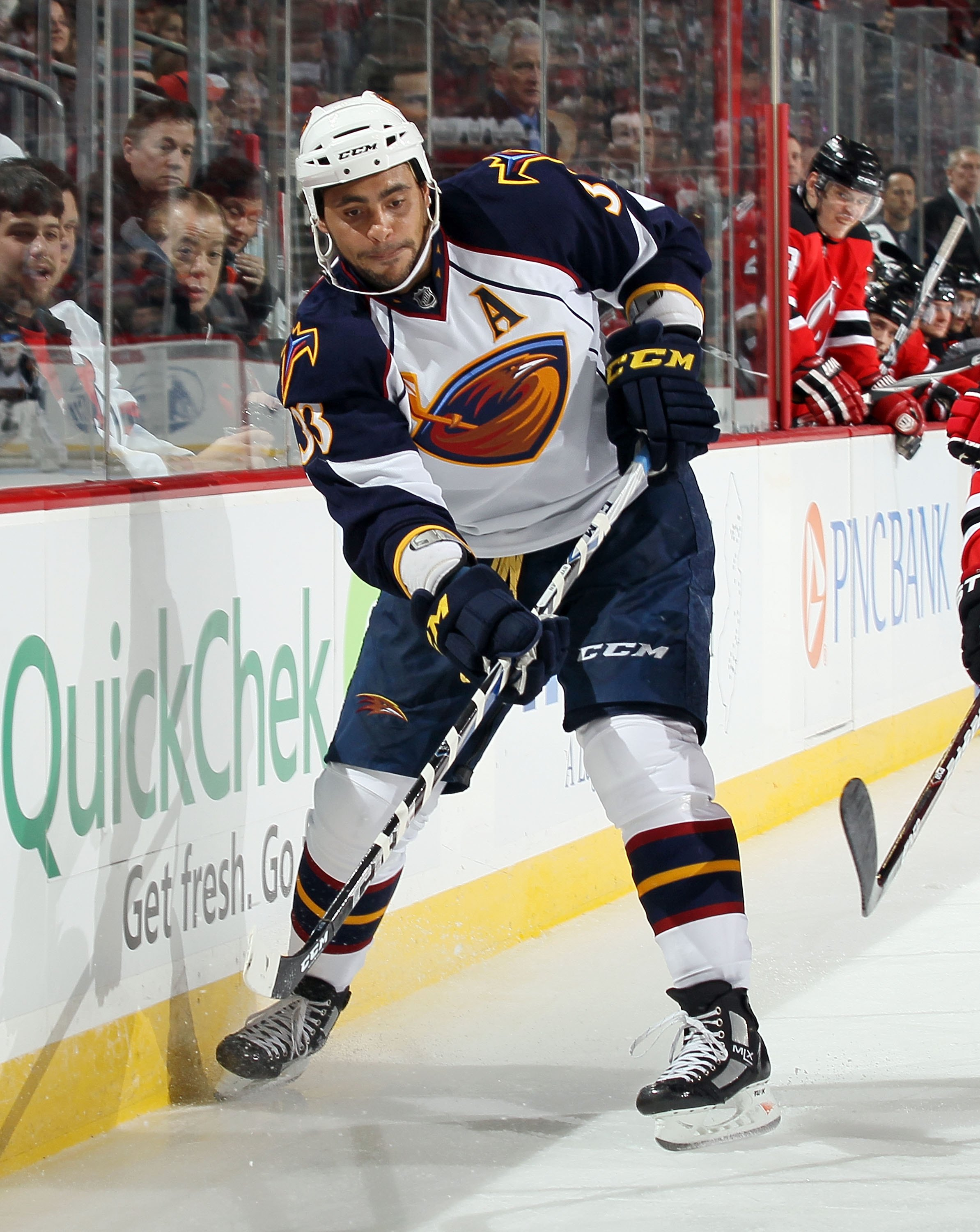 NEWARK, NJ - DECEMBER 31:  Dustin Byfuglien #33 of the Atlanta Thrashers skates against the New Jersey Devils at the Prudential Center on December 31, 2010 in Newark, New Jersey. The Devils defeated the Thrashers 3-1.  (Photo by Jim McIsaac/Getty Images)