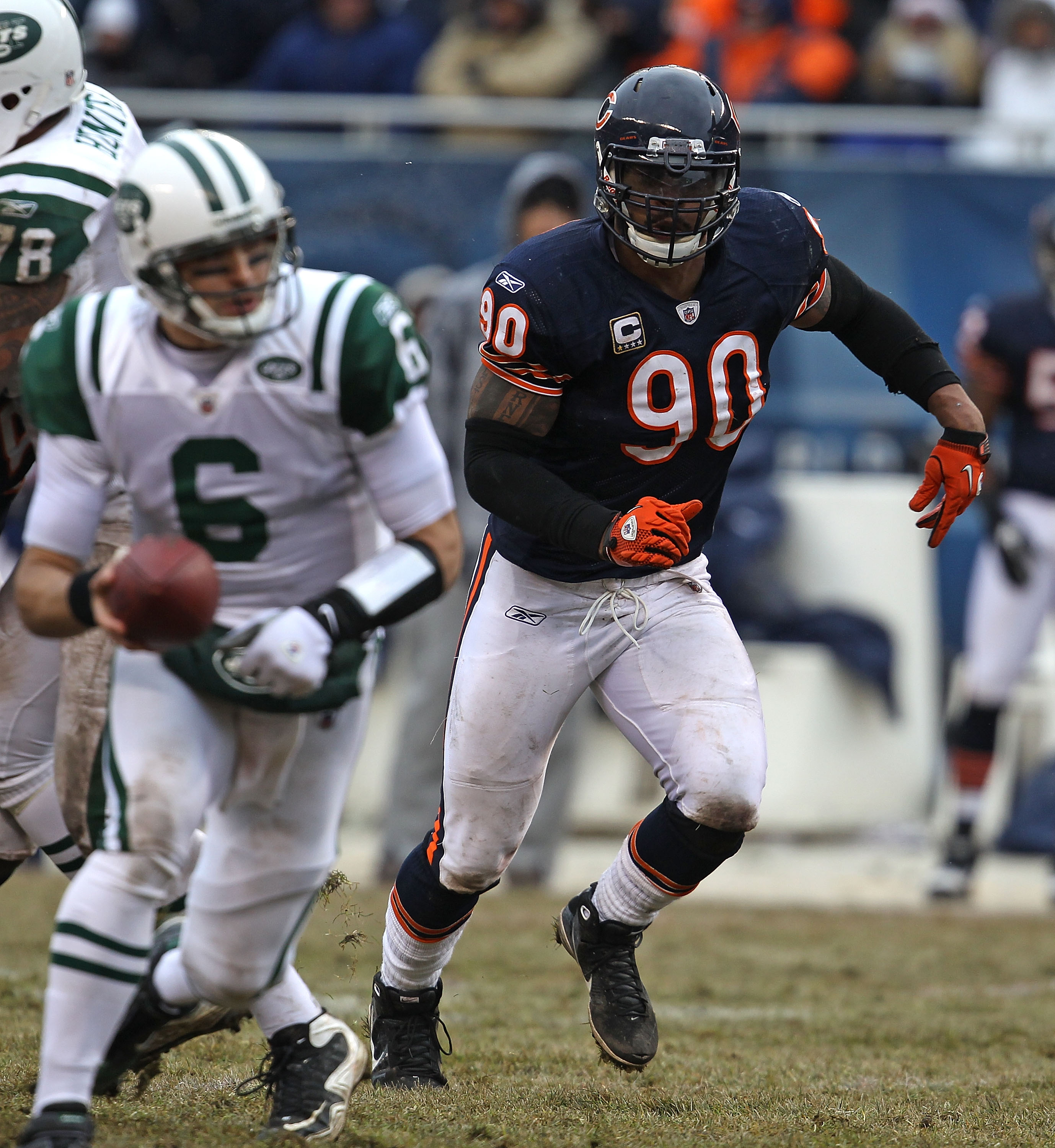 CHICAGO, IL - DECEMBER 26: Julius Peppers #90 of the Chicago Bears rushes against Mark Sanchez #6 of the New York Jets at Soldier Field on December 26, 2010 in Chicago, Illinois. The Bears defeated the Jets 38-34. (Photo by Jonathan Daniel/Getty Images)