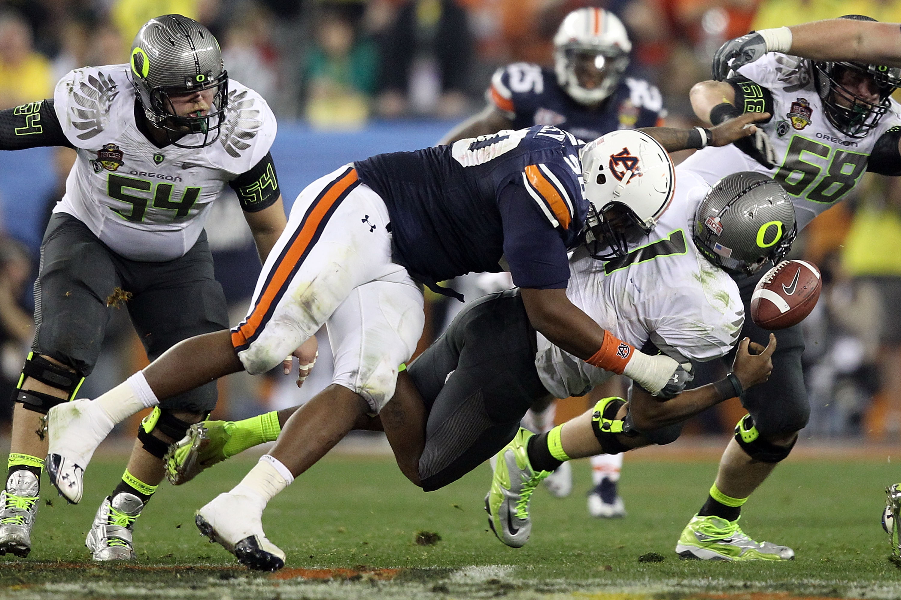 GLENDALE, AZ - JANUARY 10:  Nick Fairley #90 of the Auburn Tigers sacks Marvin Johnson #1 of the Oregon Ducks in the fourth quarter of the Tostitos BCS National Championship Game at University of Phoenix Stadium on January 10, 2011 in Glendale, Arizona.
