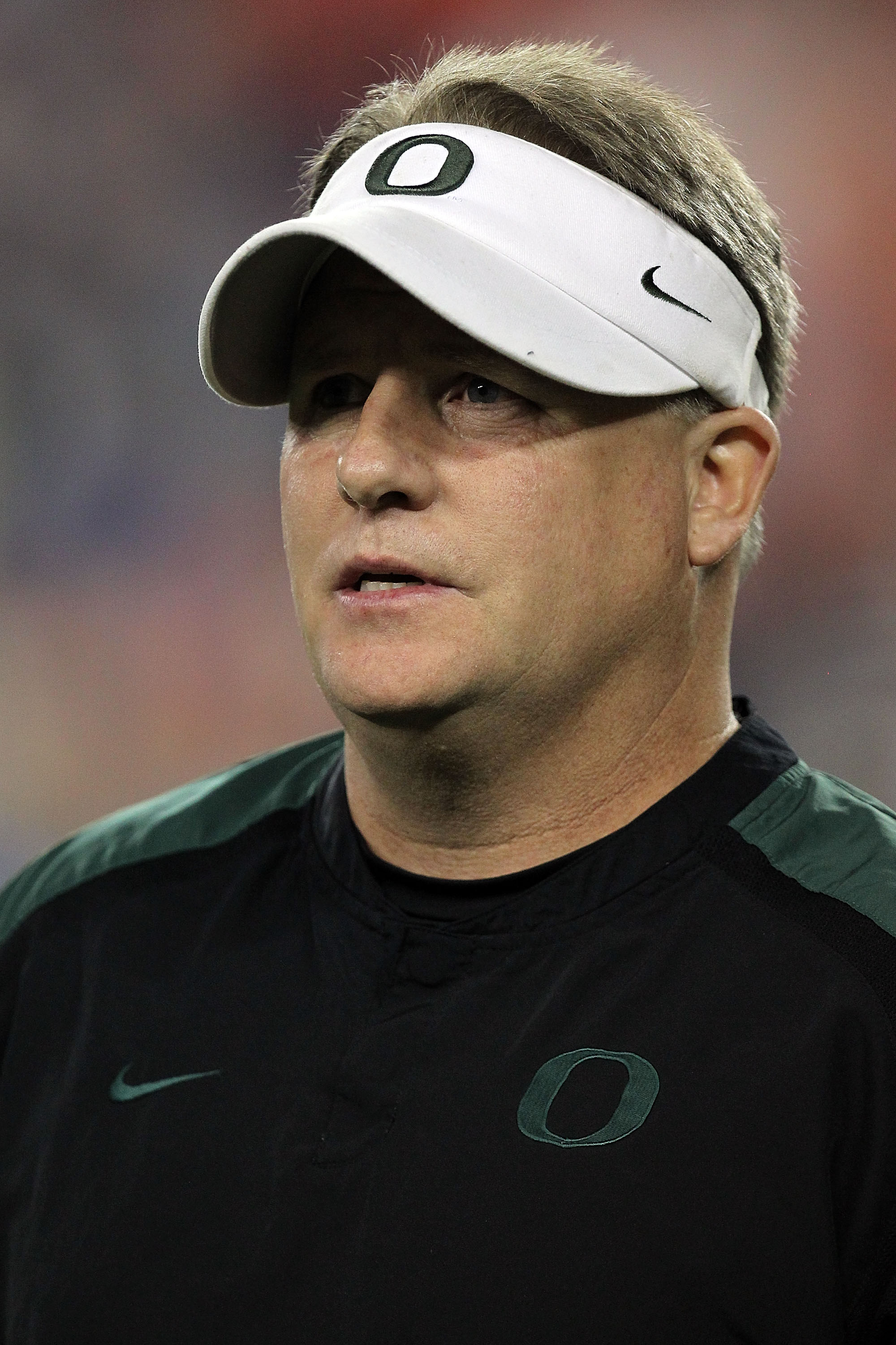 GLENDALE, AZ - JANUARY 10:  Head coach Chip Kelly of the Oregon Ducks looks on before taking on the Auburn Tigers in the Tostitos BCS National Championship Game at University of Phoenix Stadium on January 10, 2011 in Glendale, Arizona.  (Photo by Ronald M