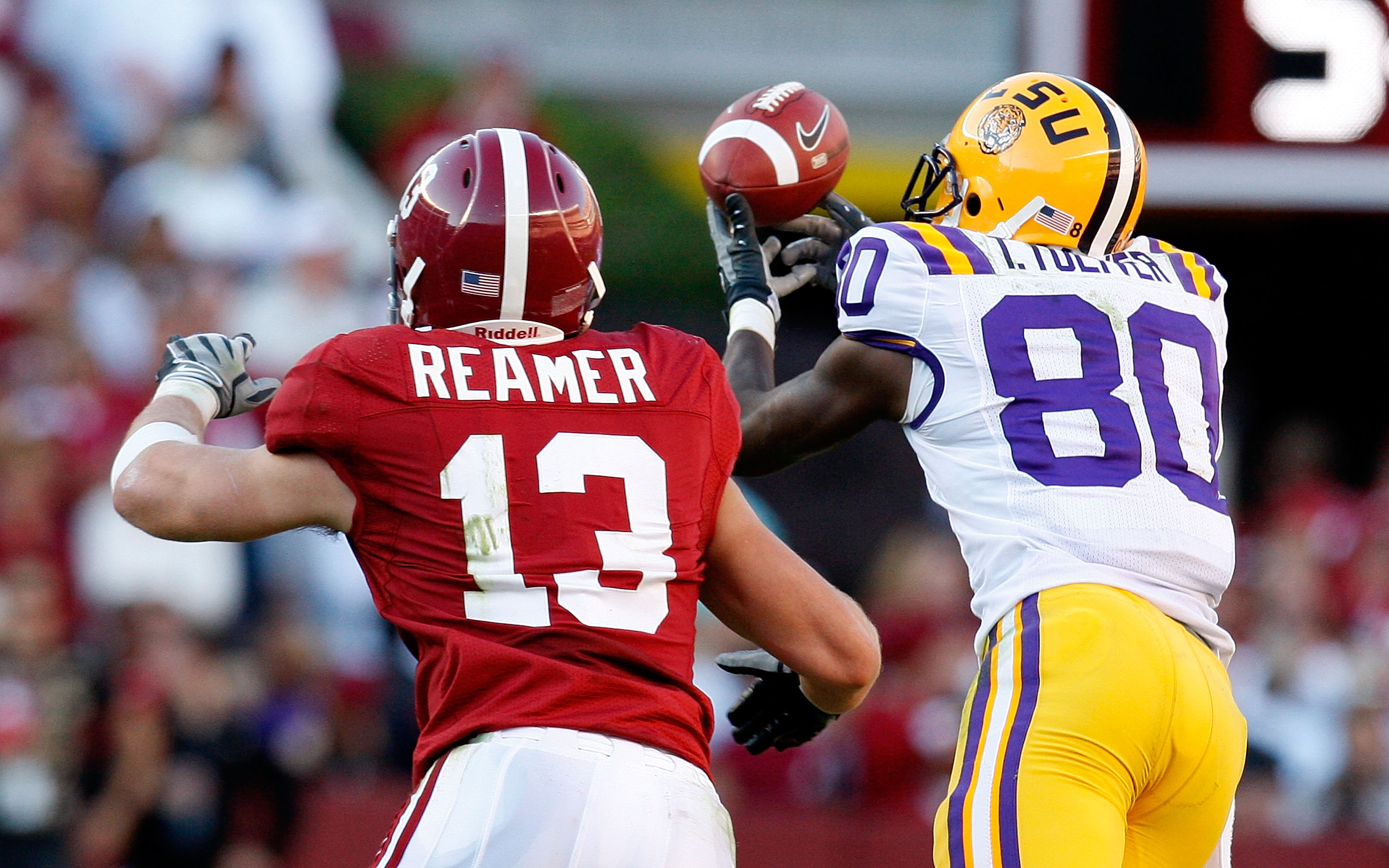 TUSCALOOSA, AL - NOVEMBER 07:  Terrance Toliver #80 of the Louisiana State University Tigers fails to pull in this reception against Cory Reamer #13 of the Alabama Crimson Tide at Bryant-Denny Stadium on November 7, 2009 in Tuscaloosa, Alabama.  (Photo by