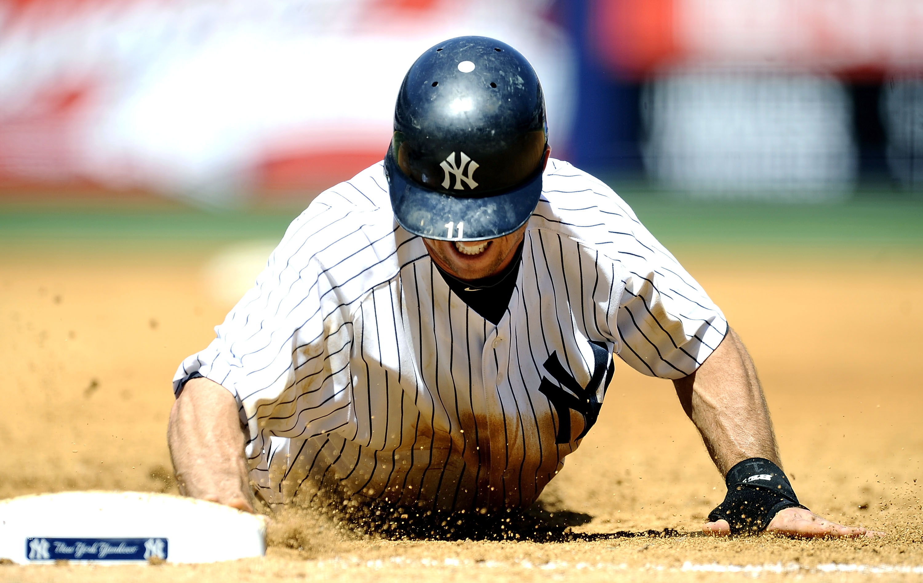 NEW YORK - MAY 05:  Brett Gardner #11 of the New York Yankees dives back to first against the Baltimore Orioles at Yankee Stadium on May 5, 2010 in the Bronx borough of New York City  (Photo by Jeff Zelevansky/Getty Images)