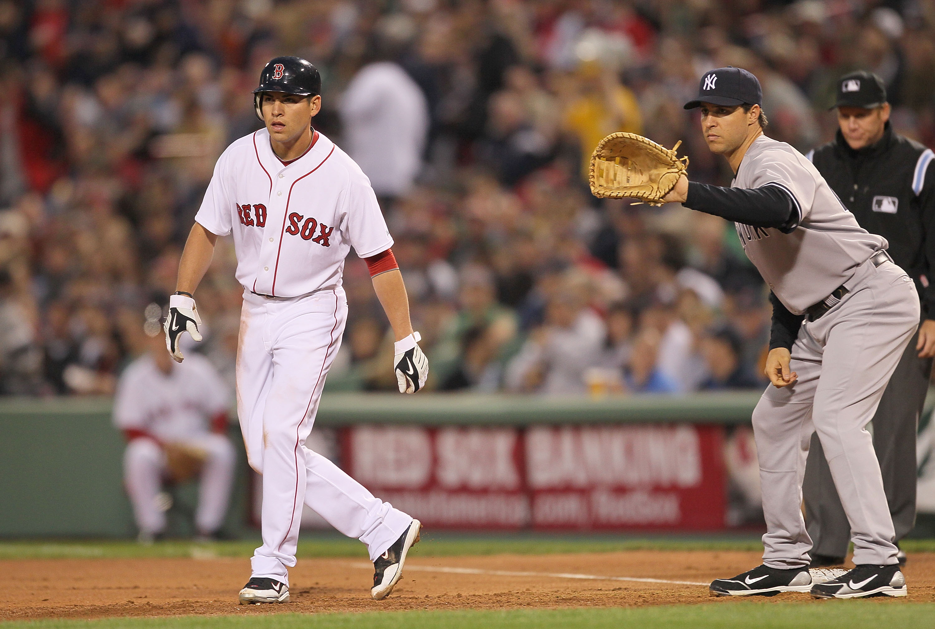 BOSTON - APRIL 06:  Jacoby Ellsbury #2 leads away from Mark Teixeira #25 of the New York Yankees at Fenway Park on April 6, 2010 in Boston, Massachusetts. (Photo by Jim Rogash/Getty Images)