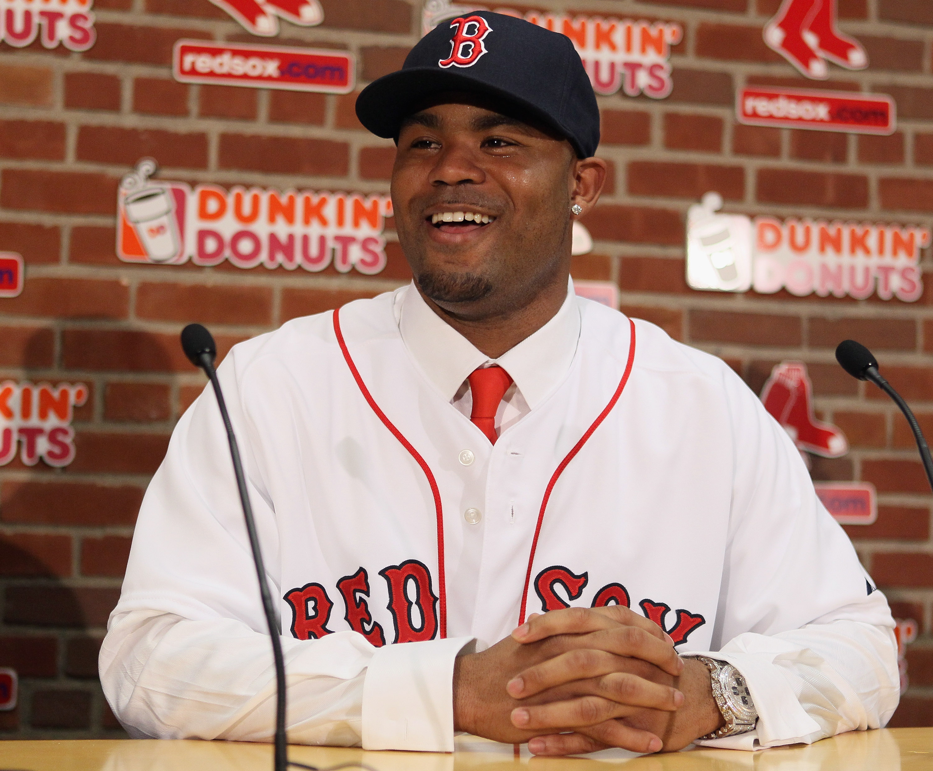BOSTON, MA - DECEMBER 11:  Carl Crawford answers questions during a press conference announcing his signing with the Boston Red Sox on December 11,  2010 at the Fenway Park in Boston, Massachusetts.  (Photo by Elsa/Getty Images)