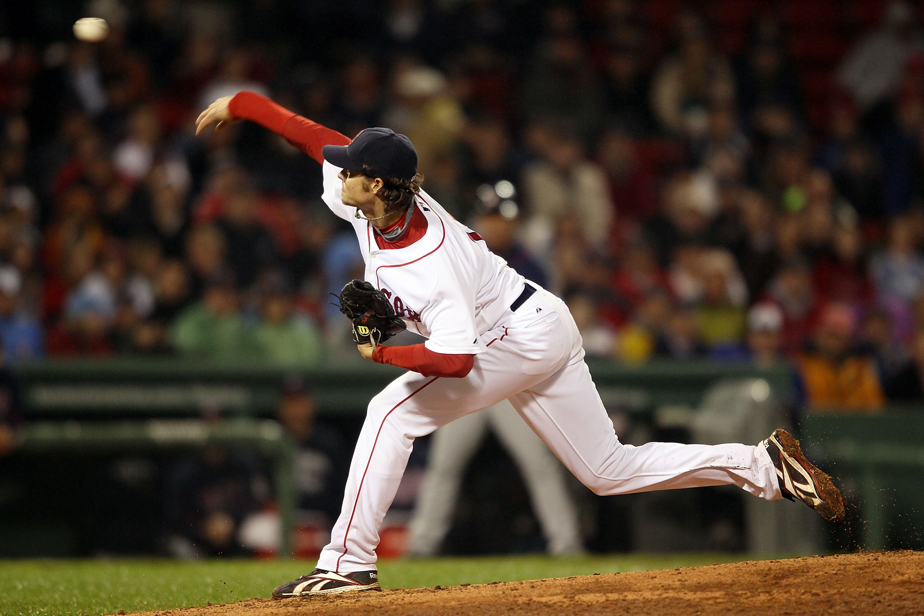 BOSTON - MAY 19:  Clay Buchholz #11 of the Boston Red Sox delivers a pitch in the top of the ninth inning against the Minnesota Twins on May 19, 2010 at Fenway Park in Boston, Massachusetts.  (Photo by Elsa/Getty Images)