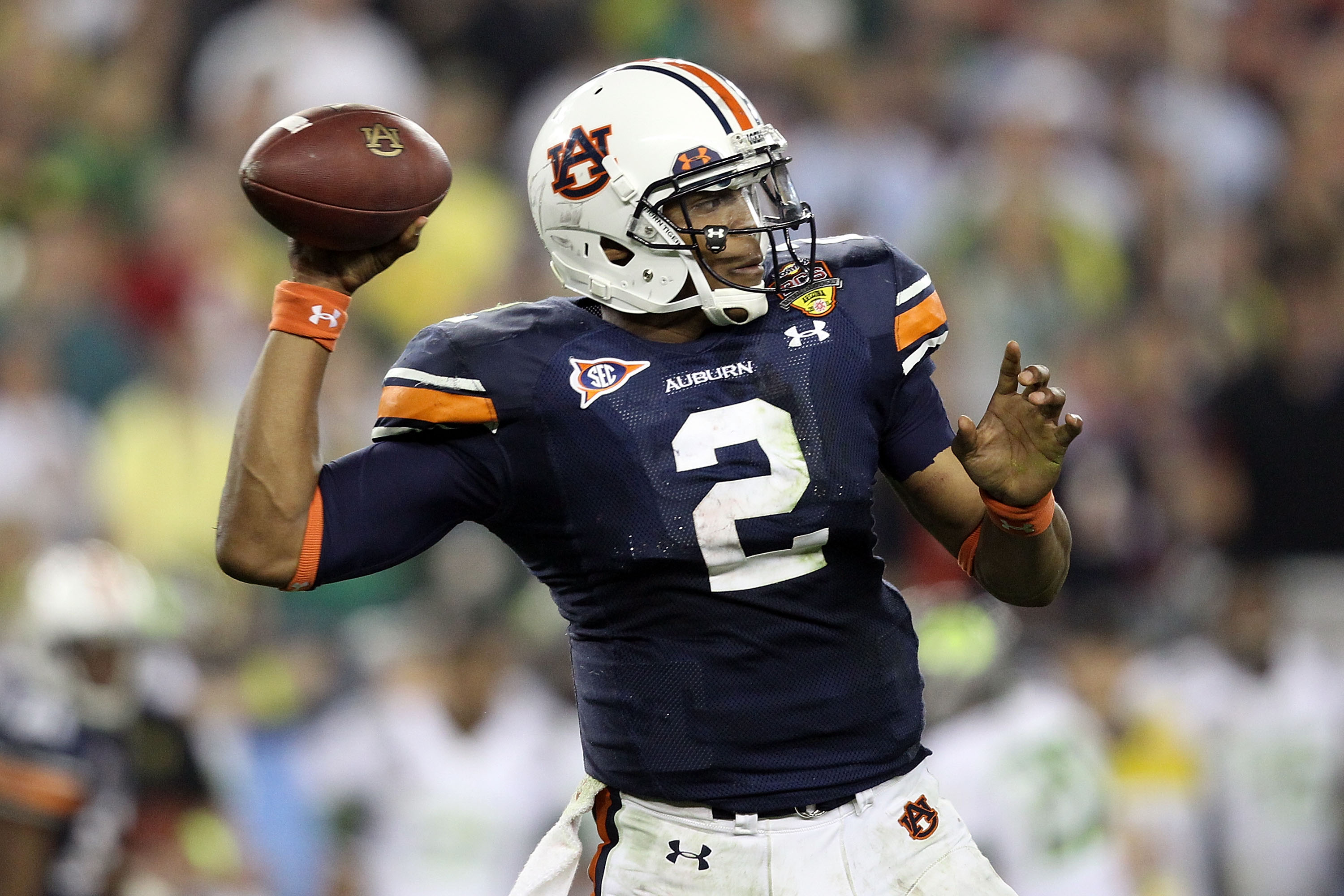 GLENDALE, AZ - JANUARY 10:  Quarterback Cameron Newton #2 of the Auburn Tigers throws the ball in the third quarter against the Oregon Ducks during the Tostitos BCS National Championship Game at University of Phoenix Stadium on January 10, 2011 in Glendal