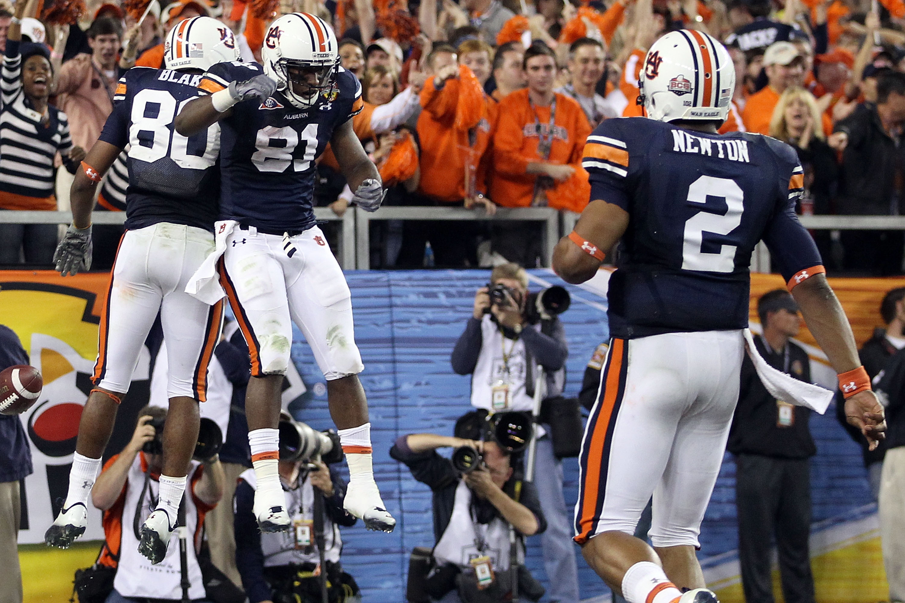 GLENDALE, AZ - JANUARY 10:  Emory Blake #80 and Terrell Zachery #81 of the Auburn Tigers celebrate Blake's second quarter touchdown as quarterback Cam Newton #2 joins them against the Oregon Ducks during the Tostitos BCS National Championship Game at Univ
