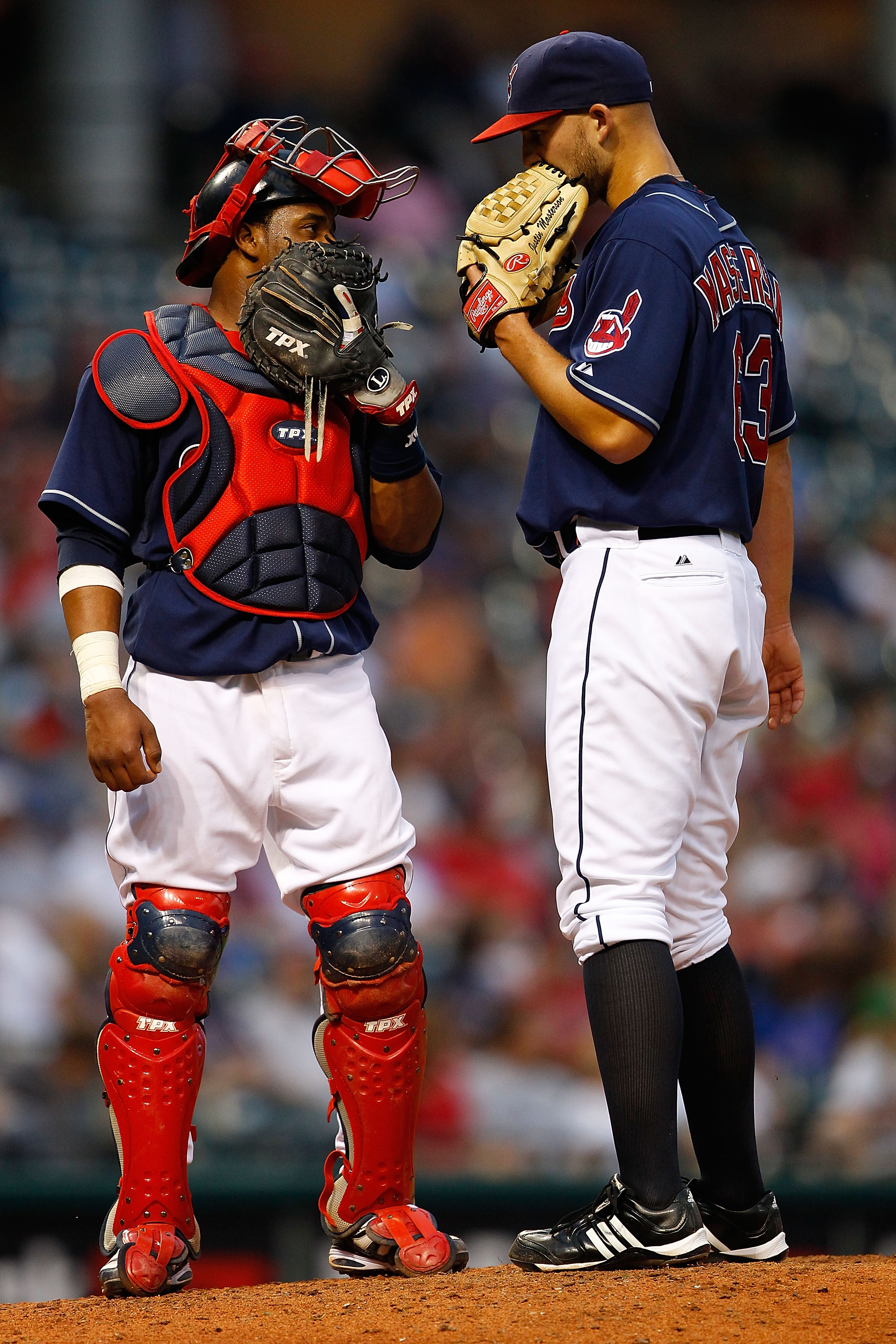 CLEVELAND - JUNE 15:  Carlos Santana #41 of the Cleveland Indians talks with teammate Justin Masterson #63 at the mound during the game against the New York Mets on June 15, 2010 at Progressive Field in Cleveland, Ohio.  (Photo by Jared Wickerham/Getty Im