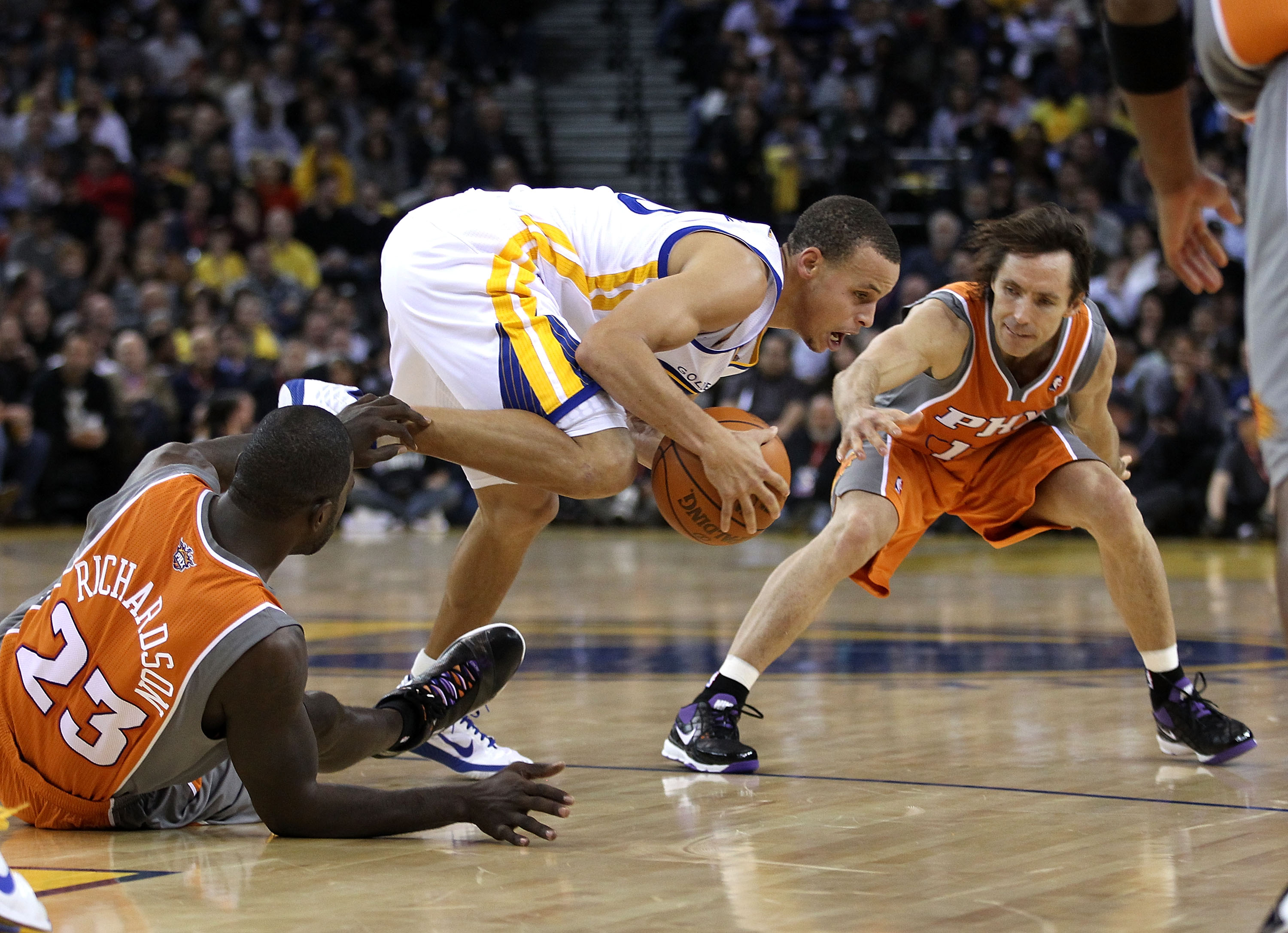 OAKLAND, CA - DECEMBER 02:  Stephen Curry #30 of the Golden State Warriors steals the ball from Jason Richardson #23 and Steve Nash #13 of the Phoenix Suns at Oracle Arena on December 2, 2010 in Oakland, California. NOTE TO USER: User expressly acknowledg