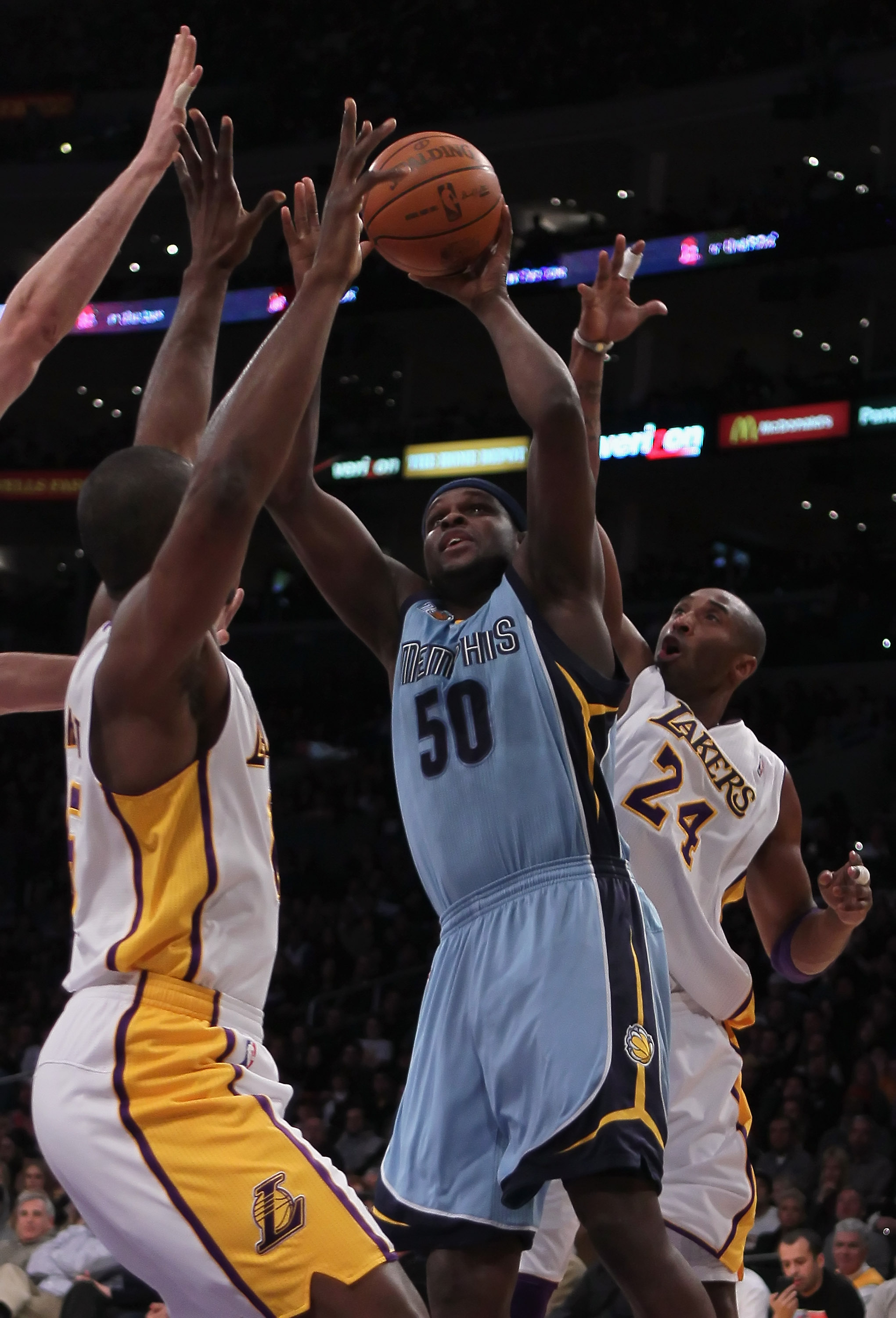 LOS ANGELES, CA - JANUARY 02:  Zach Randolph #50 of the Memphis Grizzlies is defended by Ron Artest (L) #15 and Kobe Bryant #24 of the Los Angeles Lakers during the first half at Staples Center on January 2, 2011 in Los Angeles, California. NOTE TO USER: