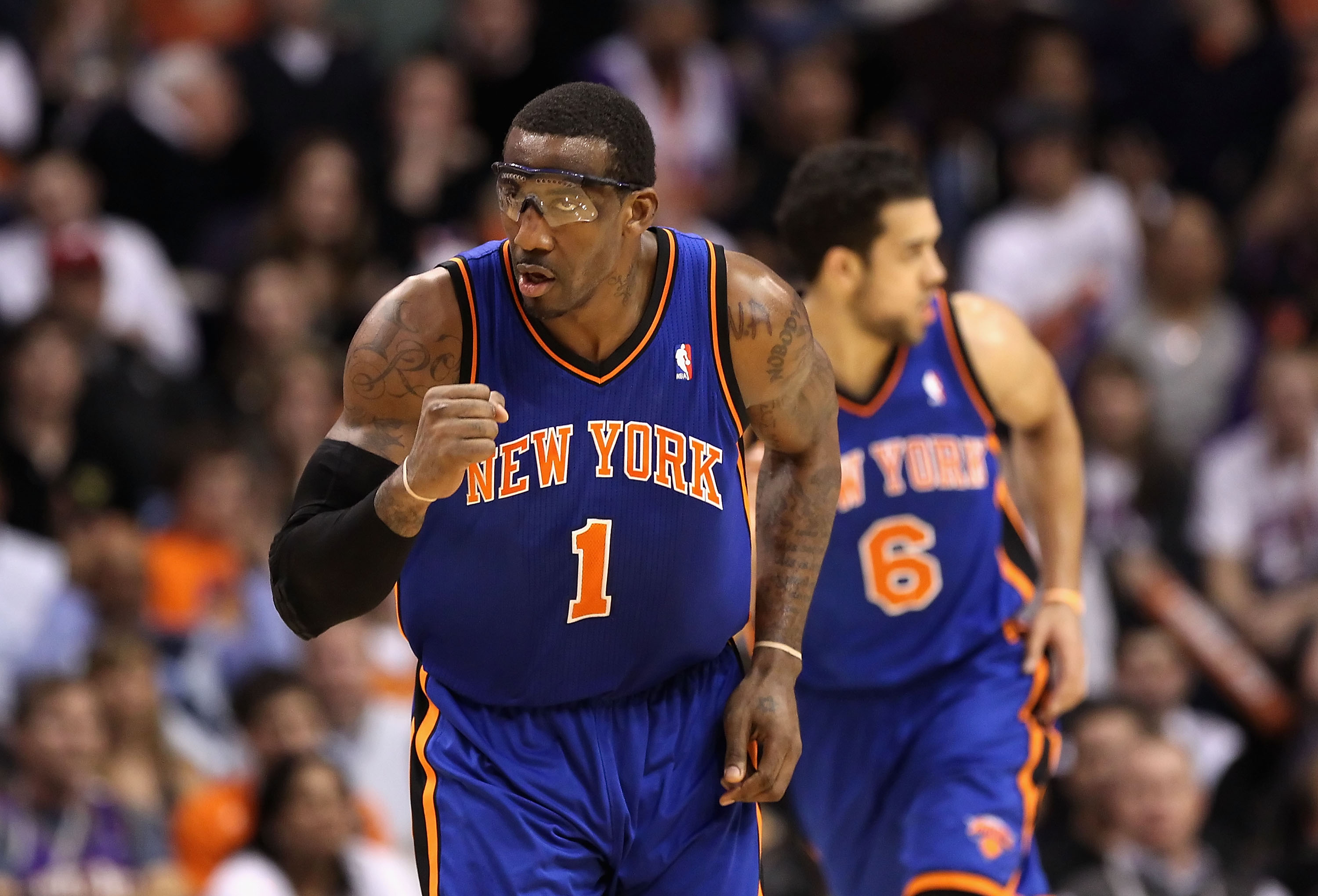 PHOENIX - JANUARY 07:  Amar'e Stoudemire #1 of the New York Knicks pumps his fist after Landry Fields #6 hit a three point shot against the Phoenix Suns during the NBA game at US Airways Center on January 7, 2011 in Phoenix, Arizona.  The Knicks defeated