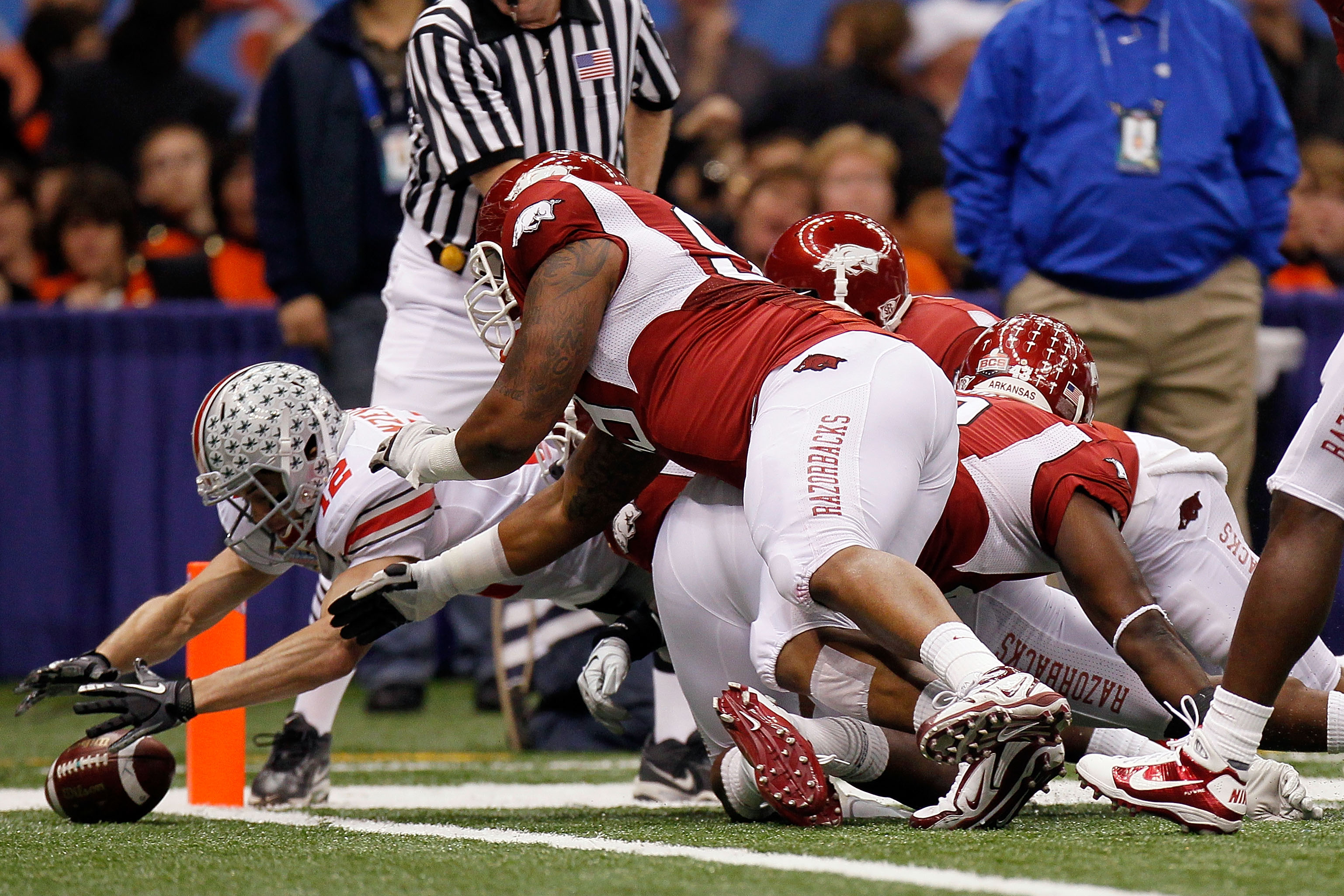NEW ORLEANS, LA - JANUARY 04:  Dane Sanzenbacher #12 of the Ohio State Buckeyes recovers a Terrelle Pryor #2 fumble in the endzone for a touchdown in the first quarter against the Arkansas Razorbacks during the Allstate Sugar Bowl at the Louisiana Superdo