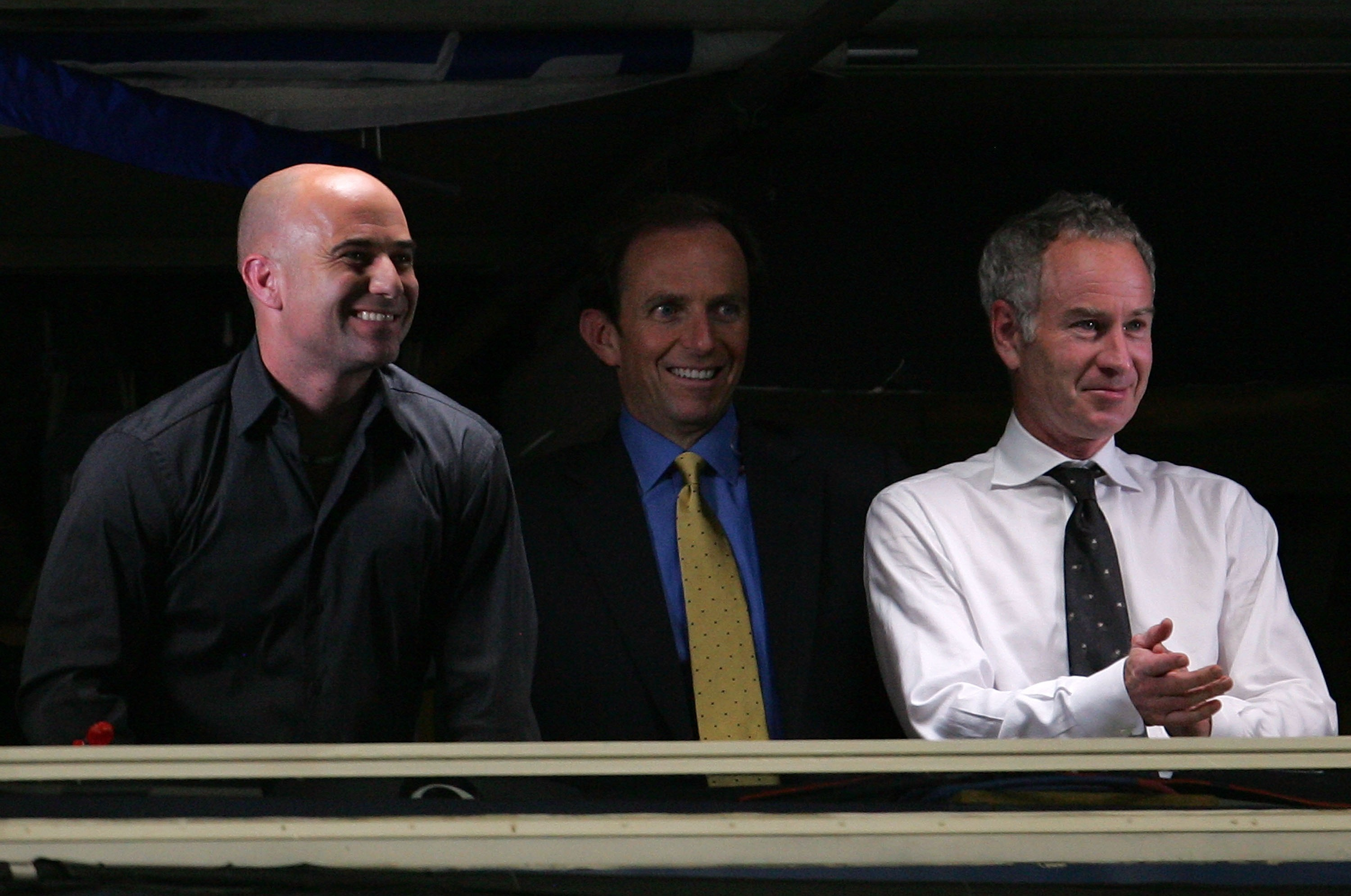 NEW YORK - SEPTEMBER 05:  (L-R) Andre Agassi, Ted Robinson and John McEnroe broadcast from the USA network booth as Andy Roddick plays against Roger Federer during day ten of the 2007 U.S. Open at the Billie Jean King National Tennis Center on September 5