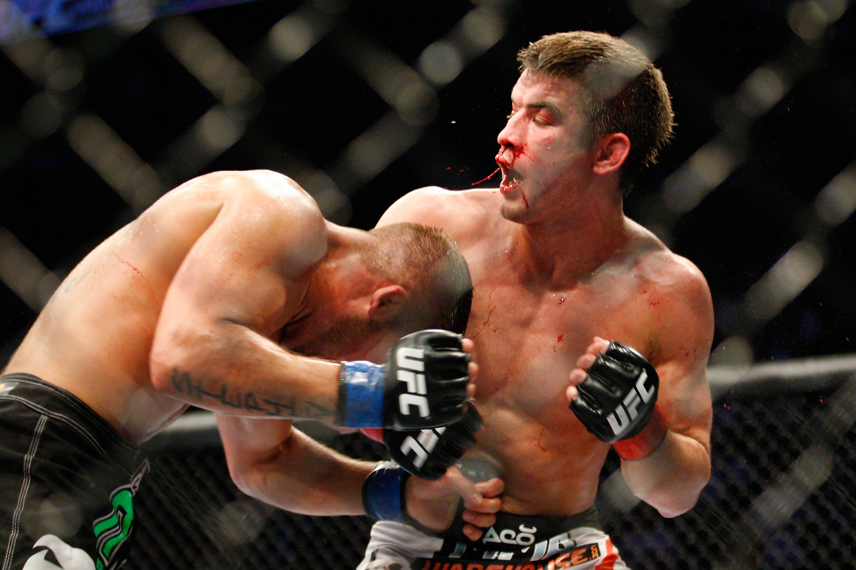 MONTREAL- MAY 8: Jeremy Stephens (L) punches Sam Stout in the stomach in their lightweight 'swing' bout at UFC 113 at Bell Centre on May 8, 2010 in Montreal, Quebec, Canada.  (Photo by Richard Wolowicz/Getty Images)