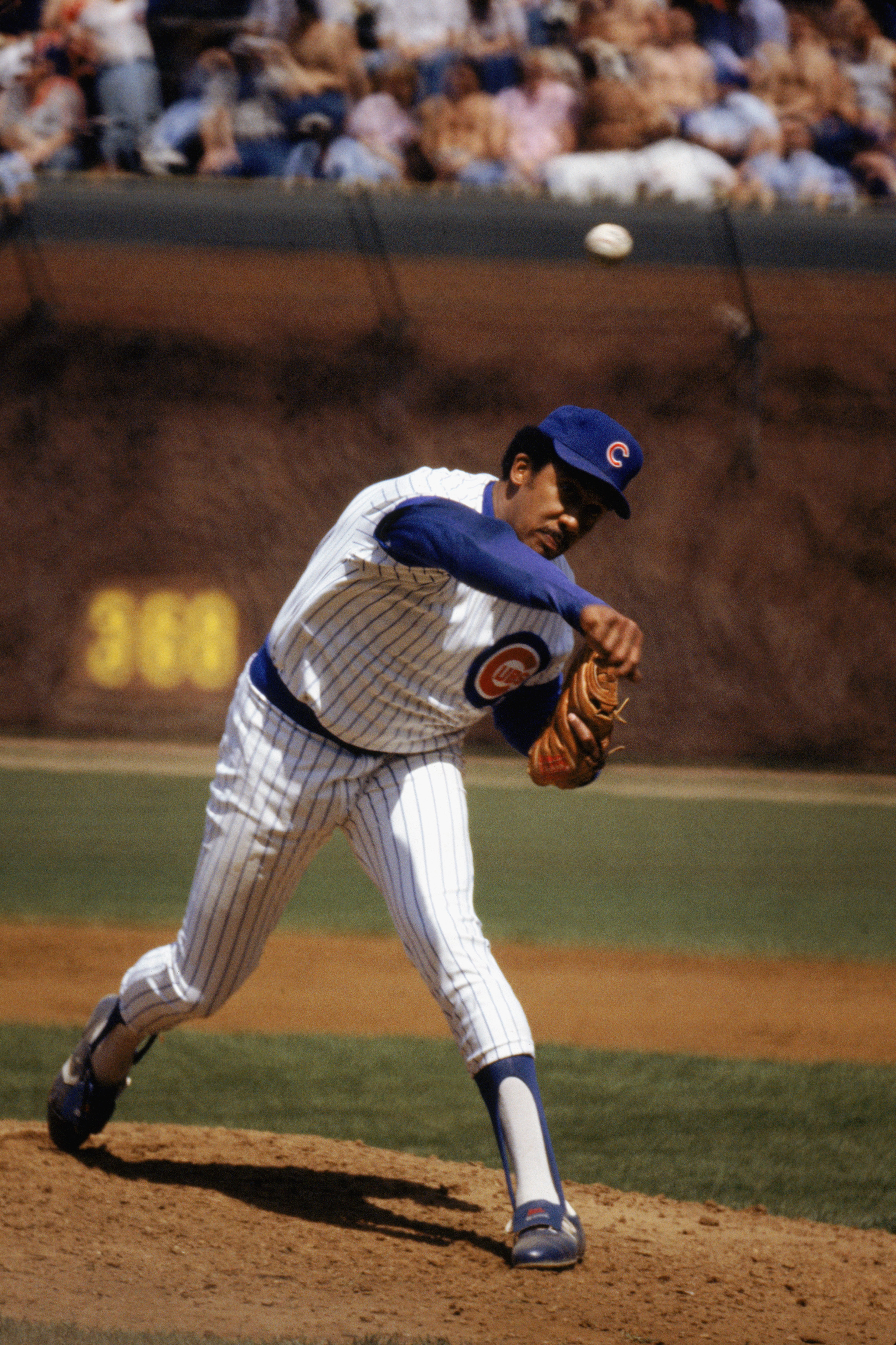CHICAGO - 1983:  Fergie Jenkins # 31 of the Chicago Cubs pitches in a game during the 1983 season at Wrigley Field in Chicago, Illinois.  (Photo by: Jonathan Daniel/Getty Images)