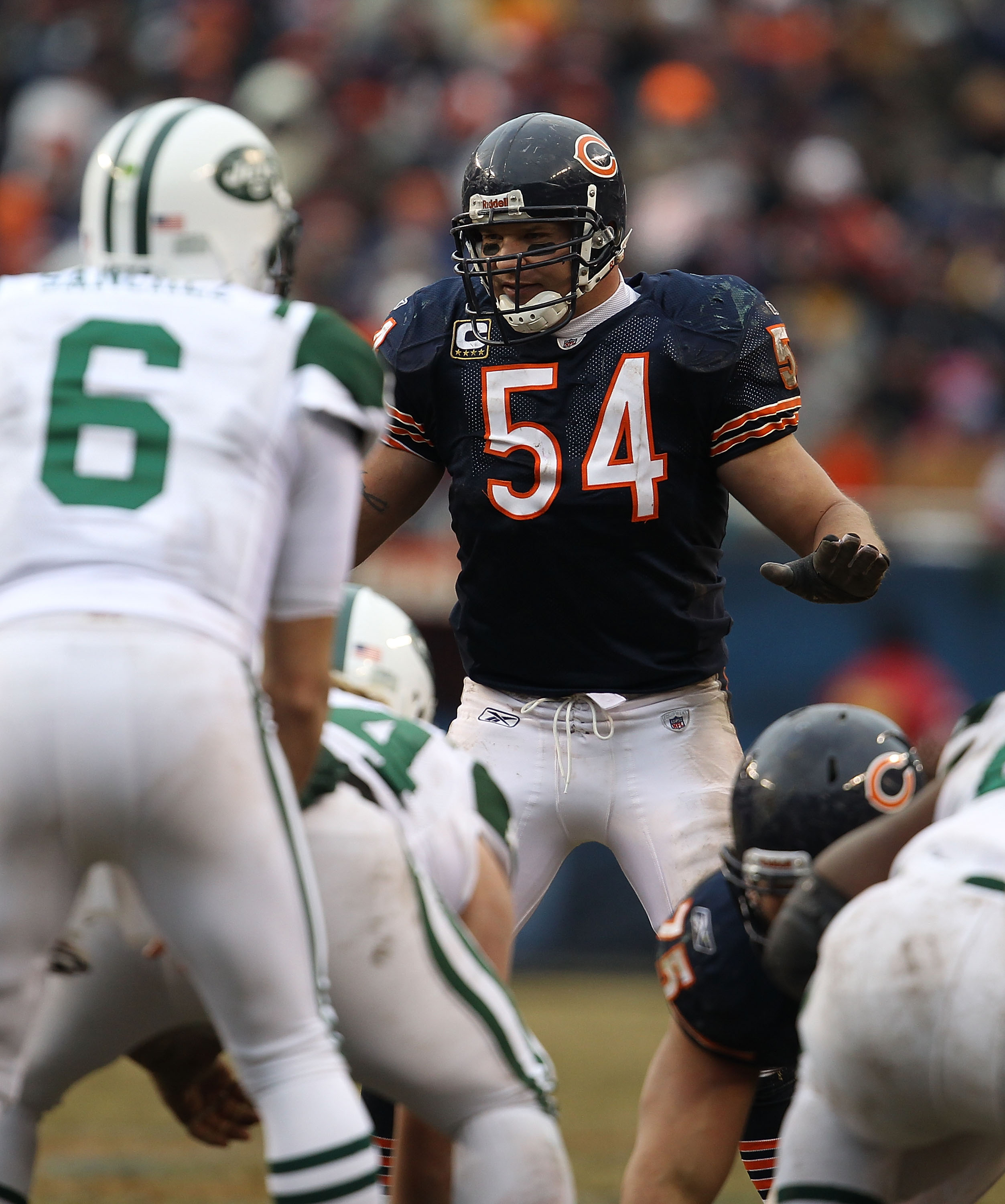 CHICAGO, IL - DECEMBER 26: Brian Urlacher #54 of the Chicago Bears awaits the start of play as Mark Sanchez #6 of the New York Jets calls offensive signals at Soldier Field on December 26, 2010 in Chicago, Illinois. The Bears defeated the Jets 38-34.  (Ph