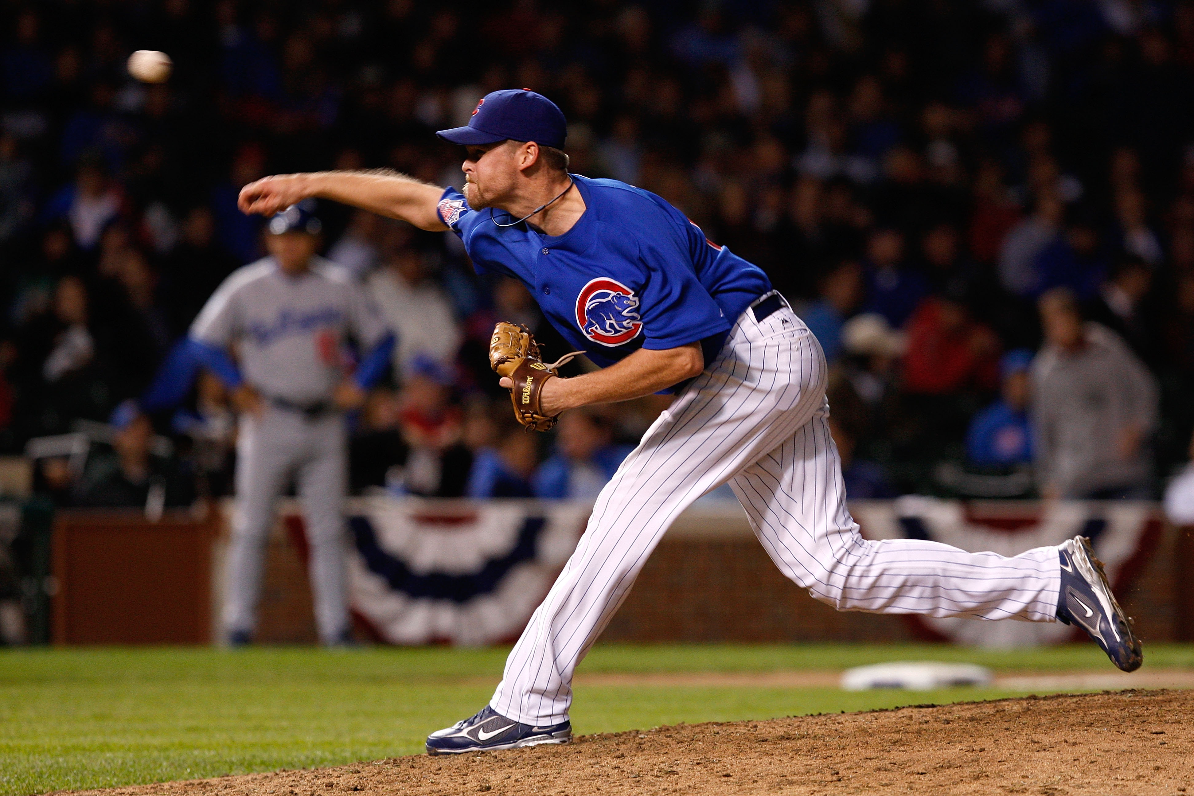 CHICAGO - OCTOBER 02:  Kerry Wood #34 of the Chicago Cubs throws a pitch against the Los Angeles Dodgers in Game Two of the NLDS during the 2008 MLB Playoffs at Wrigley Field on October 2, 2008 in Chicago, Illinois. The Dodgers won 10-3. (Photo by Jamie S