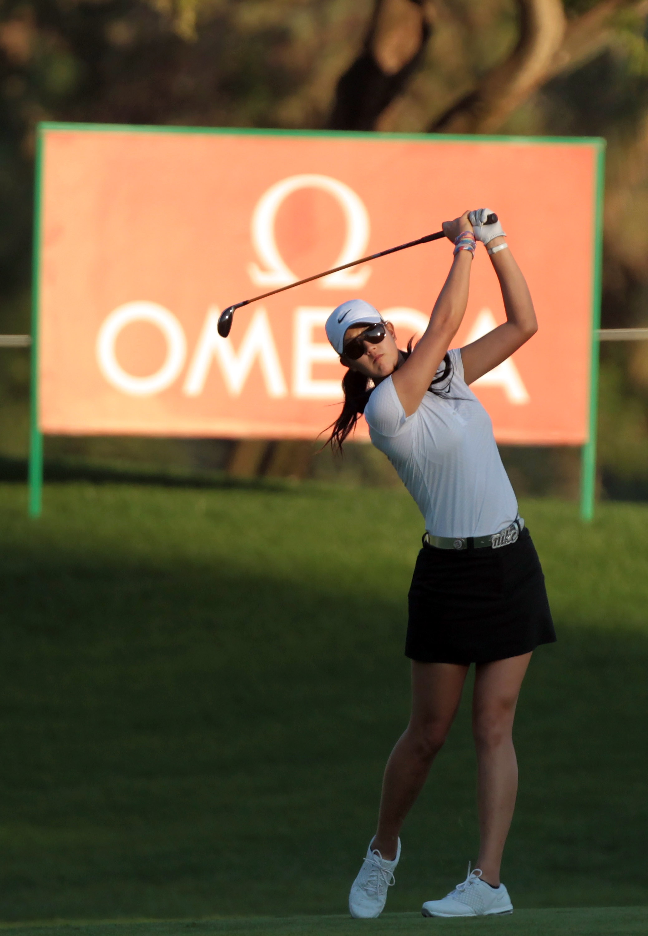 DUBAI, UNITED ARAB EMIRATES - DECEMBER 09:  Michelle Wie of the USA plays her second shot at the 18th hole during the second round of the 2010 Omega Dubai Ladies Masters on the Majilis Course at The Emirates Golf Club on December 9, 2010 in Dubai, United