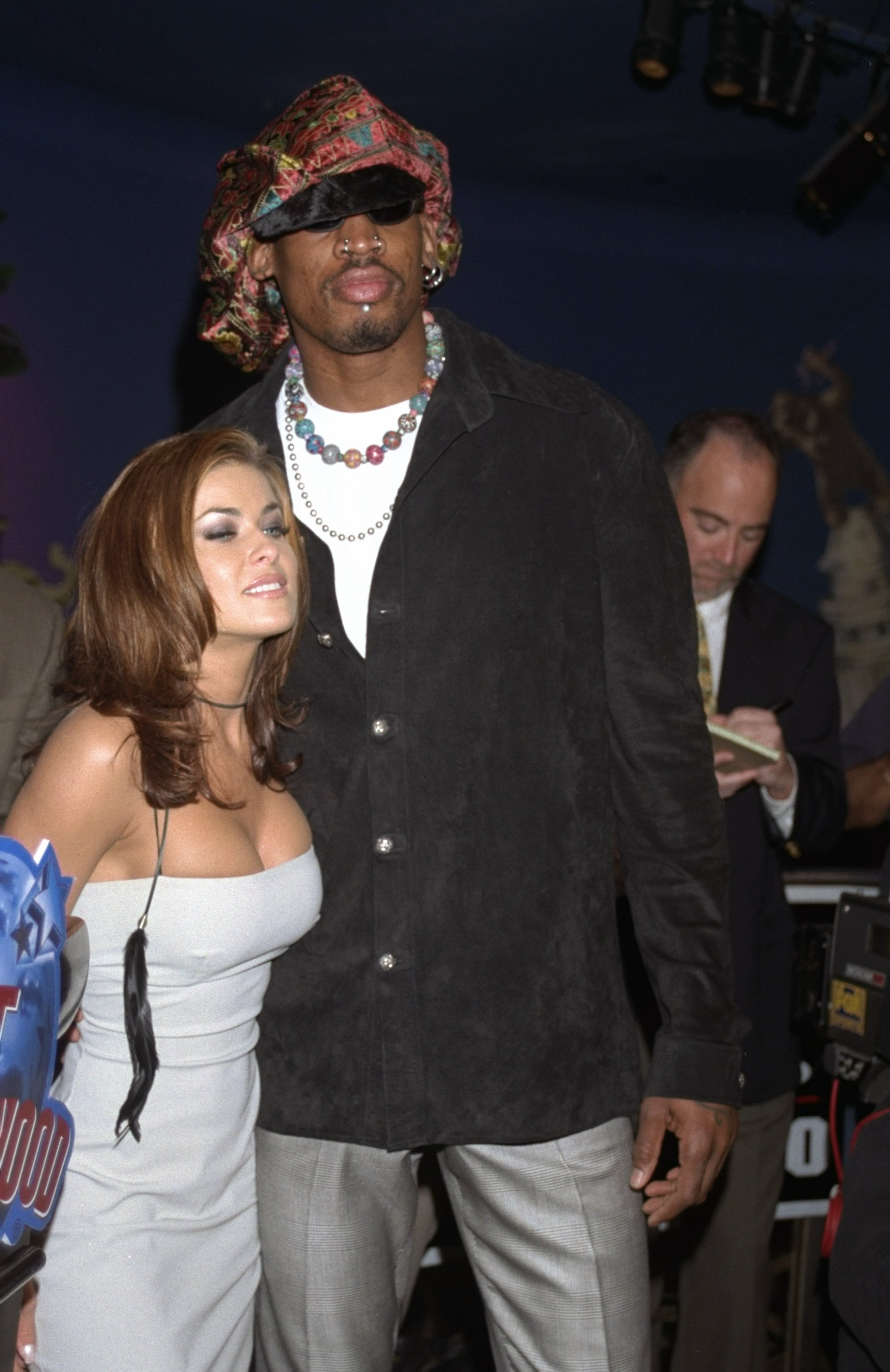 22 Mar 1999:  Dennis Rodman stands with his wife Carmen Electra during a press conference at the Planet Hollywood restaurant in Hollywood, California.  Mandatory Credit:  STEVE GRAYSON  /Allsport